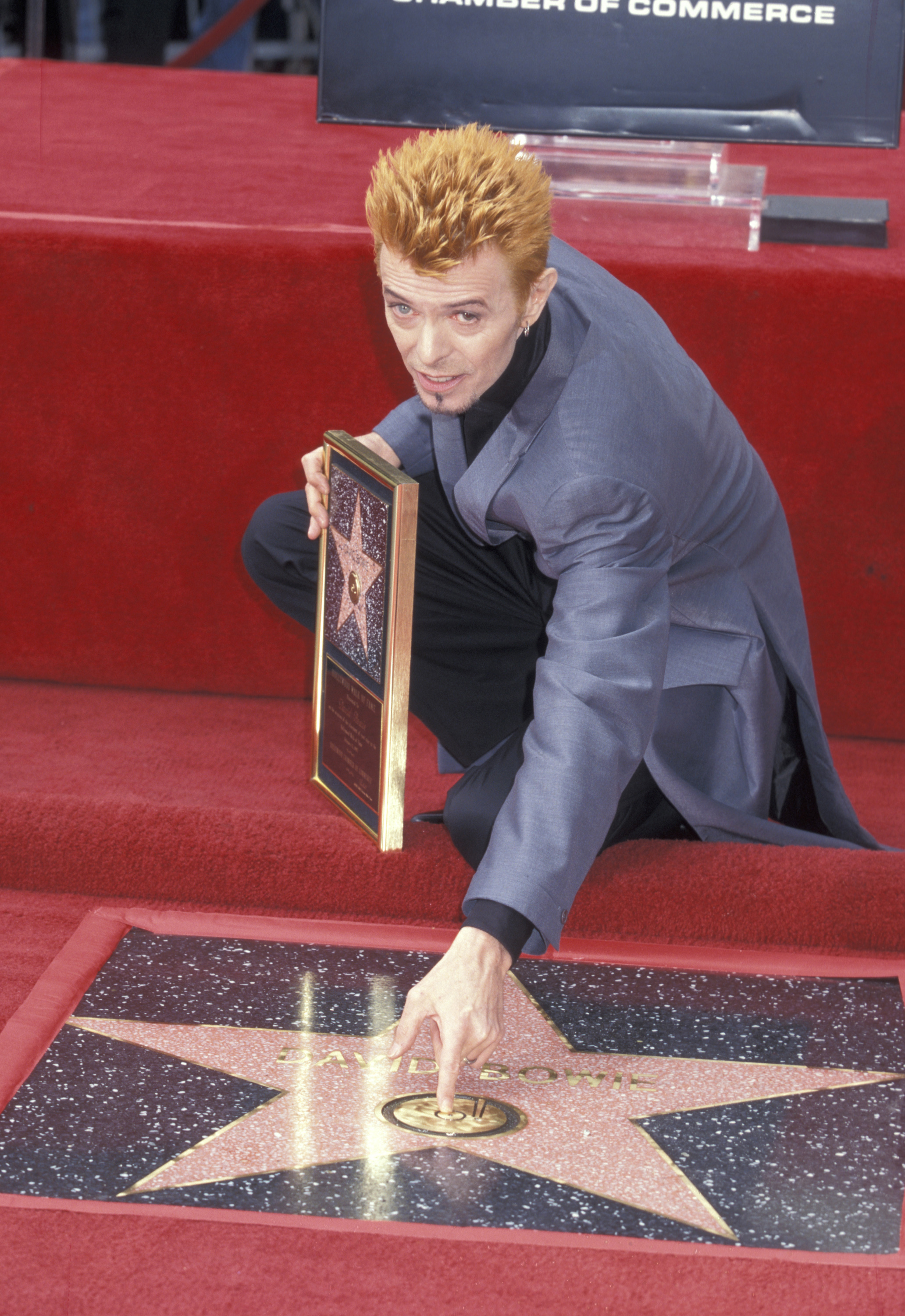 David Bowie is seen while being honored with a star on the Hollywood Walk of Fame in Hollywood, Calif. on Feb. 12, 1997.
