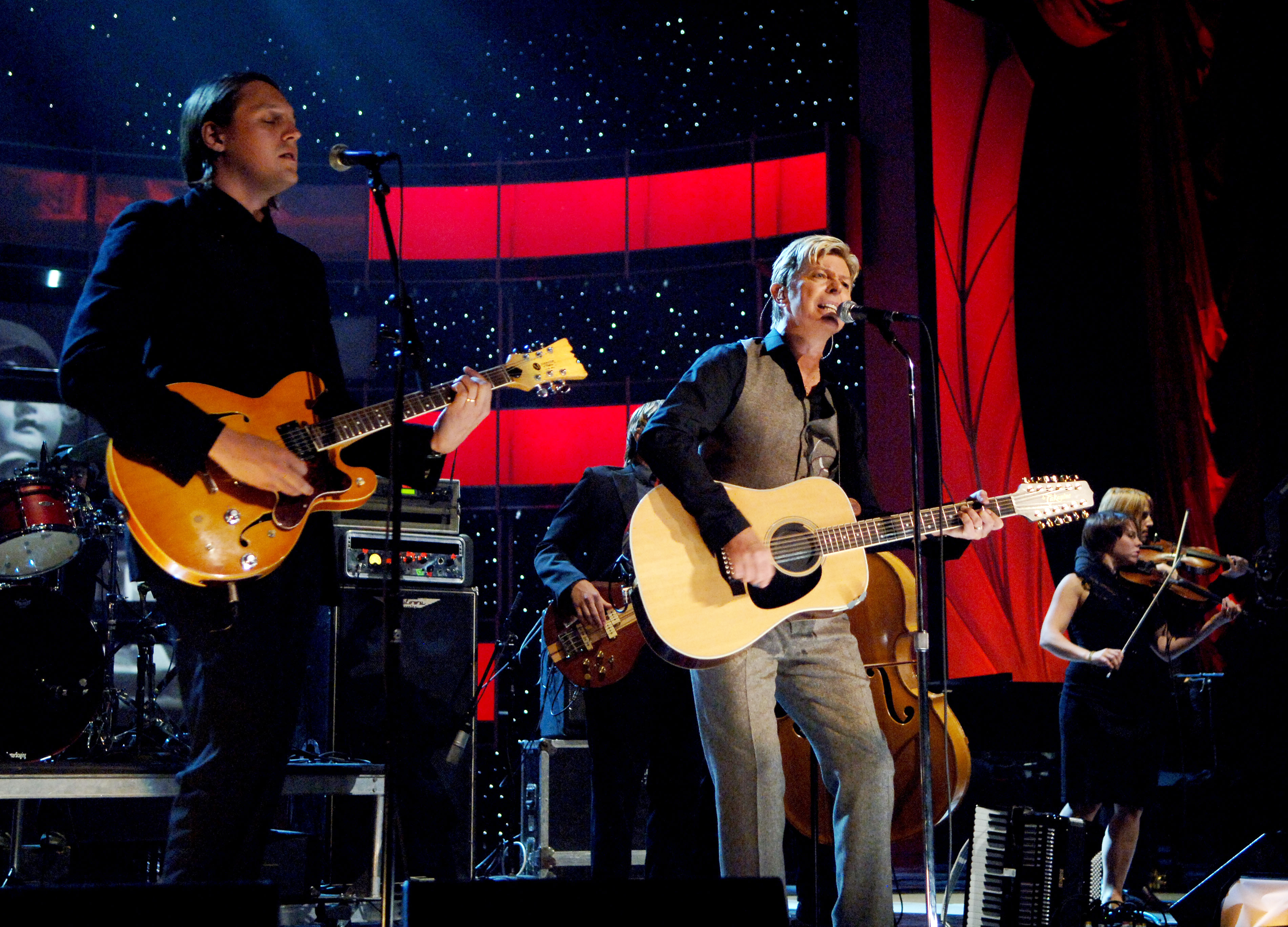David Bowie performs with Arcade Fire at Conde Nast's 2005 Fashion Rocks Show on Sept. 8, 2005 in New York City.