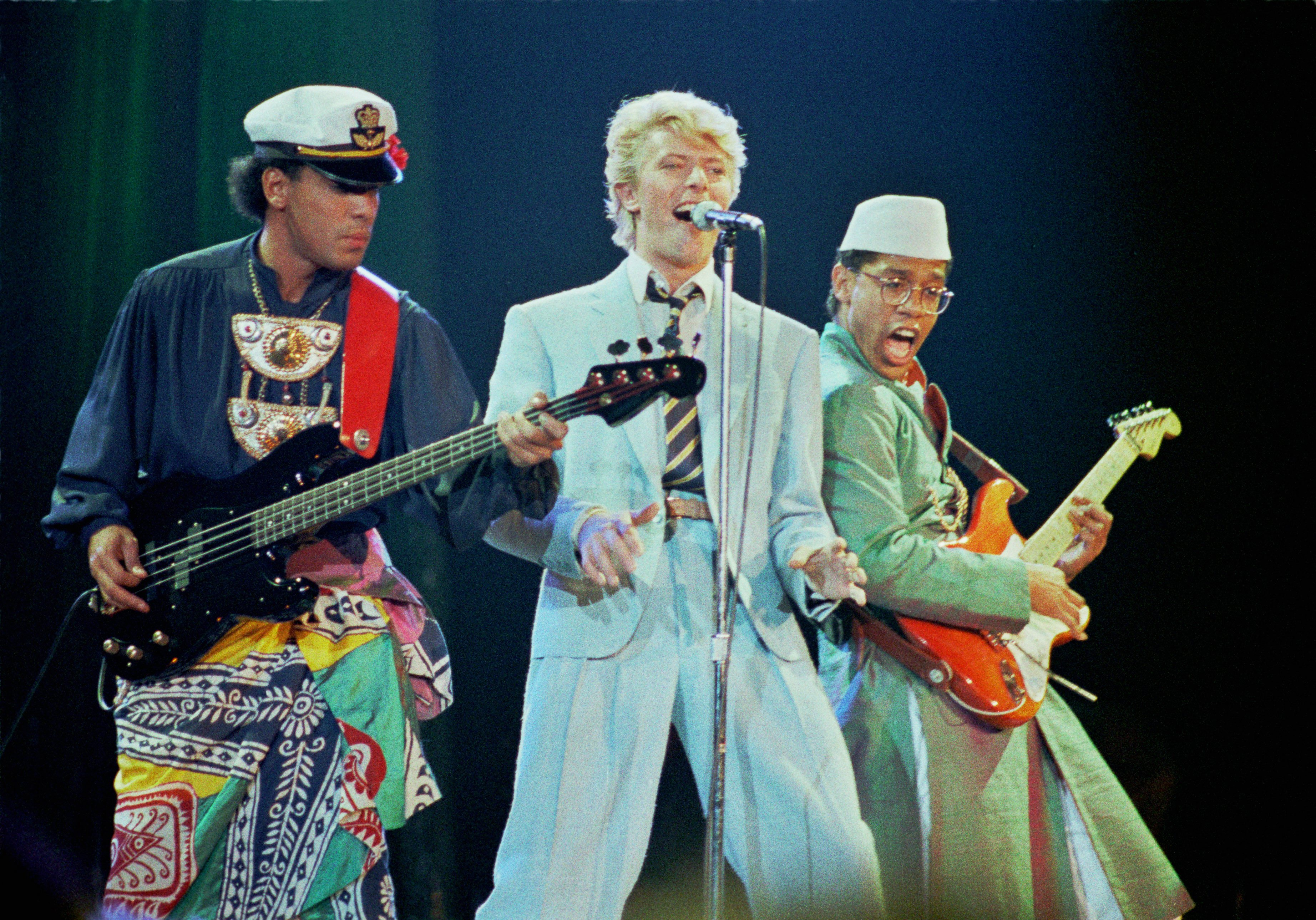 From left: Carmine Rojas, David Bowie, and Carlos Alomar perform during the Serious Moonlight tour in 1983 at Wembley Arena in London.