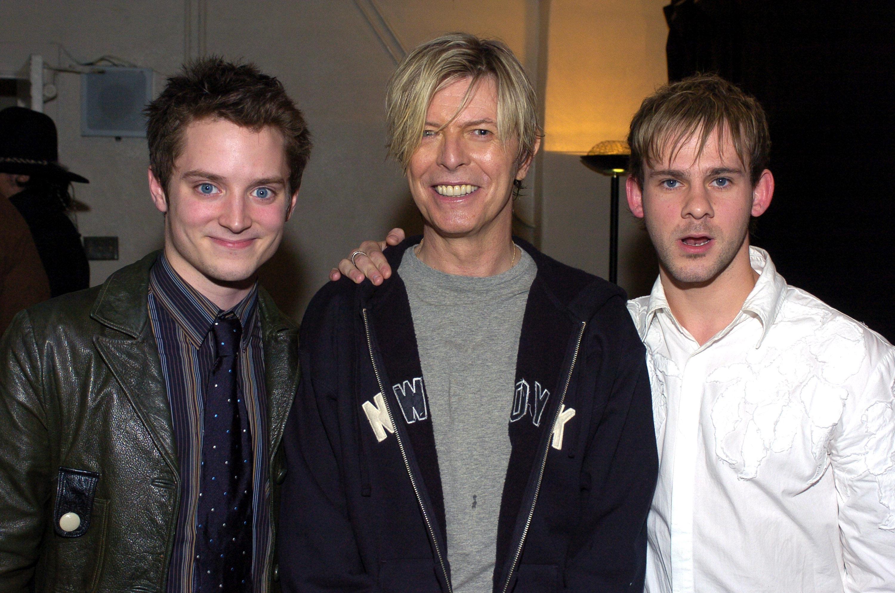 The Lord of the Rings  Trilogy stars Elijah Wood(L) and Dominic Monaghan (R) with David Bowie seen backstage at BOWIE's first concert visit to Los Angeles in nearly seven years.