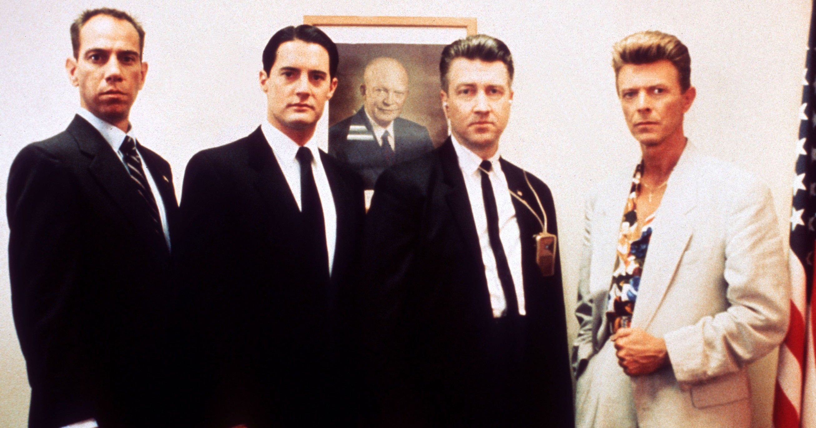 From left: Miguel Ferrer, Kyle MacLachlan, David Lynch, and David Bowie on the set of Twin Peaks: Fire Walk with Me in 1991.