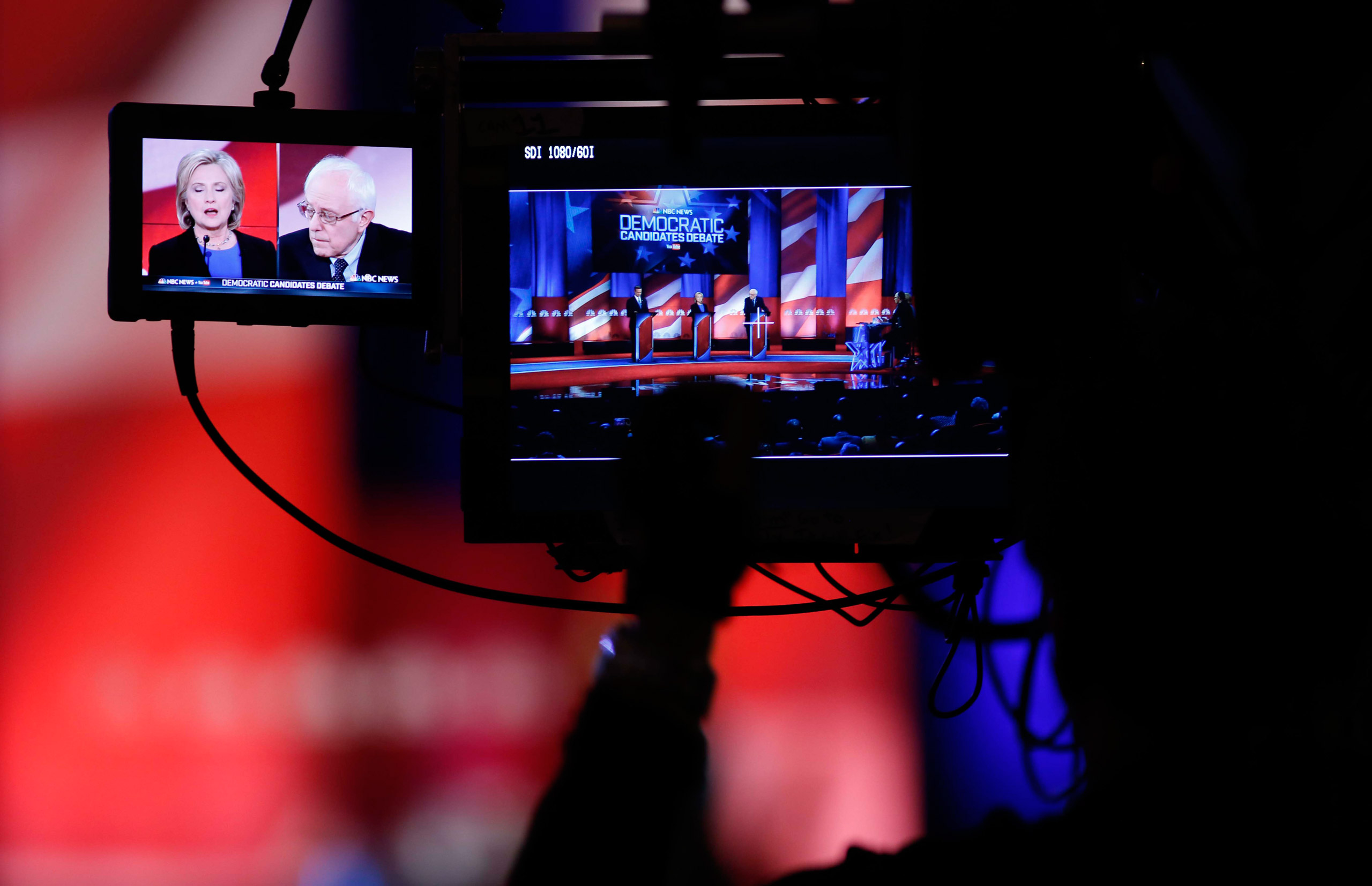 A camera man focuses on Democratic presidential candidates Hillary Clinton and Sen. Bernie Sanders as they participate in the NBC - YouTube Democratic presidential debate at the Gaillard Center in Charleston, S.C. on Jan. 17, 2016.