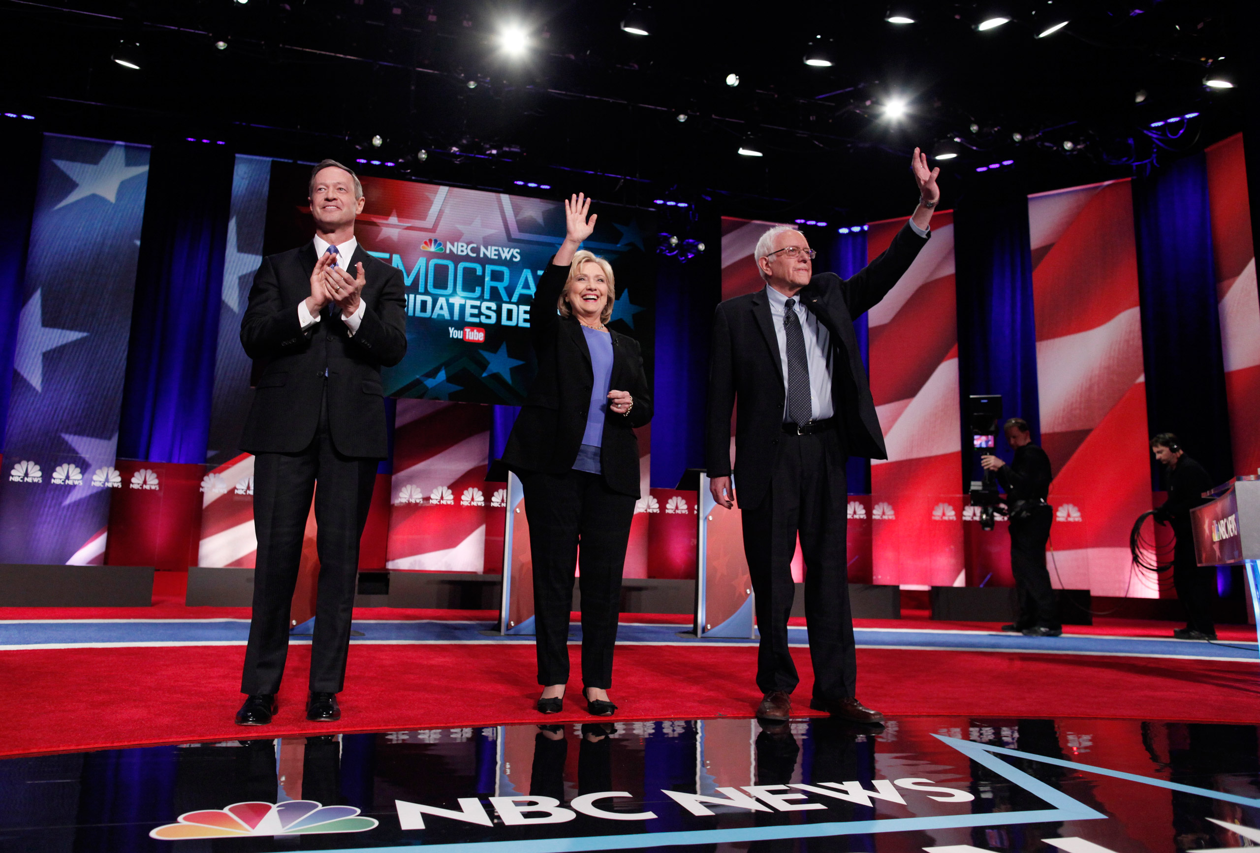 Democratic U.S. presidential candidates (L-R) former Governor Martin O'Malley, former Secretary of State Hillary Clinton and Senator Bernie Sanders pose together before the start of the NBC - YouTube Democratic presidential debate at the Gaillard Center in Charleston, S.C. on Jan. 17, 2016.