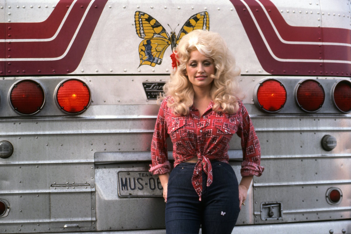 Dolly Parton poses for a portrait by her tour bus before performing in September 1977 in Detroit