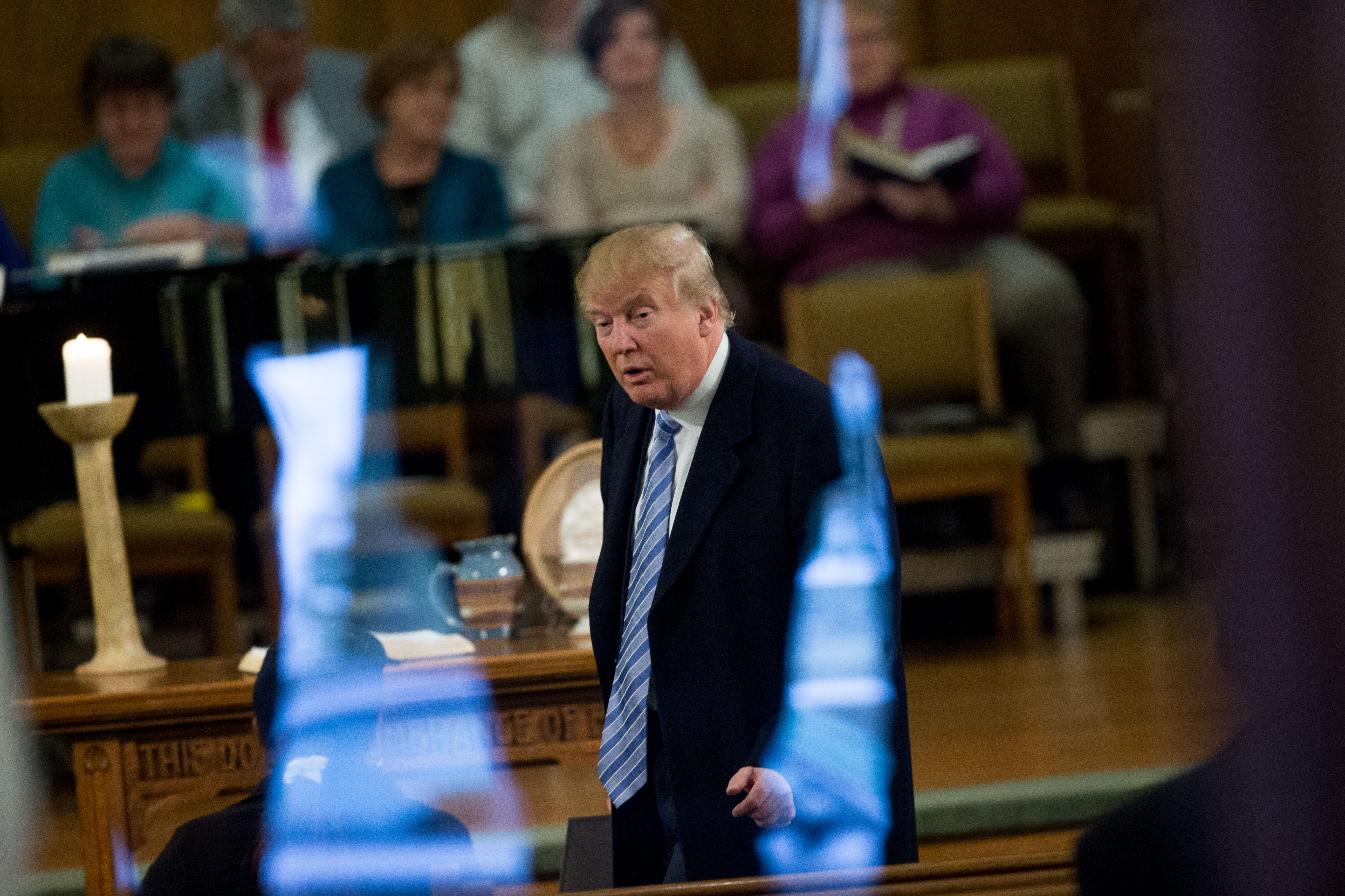 Republican presidential candidate Donald Trump arrives for service at First Presbyterian Church in Muscatine, Iowa, Sunday, Jan. 24, 2016.