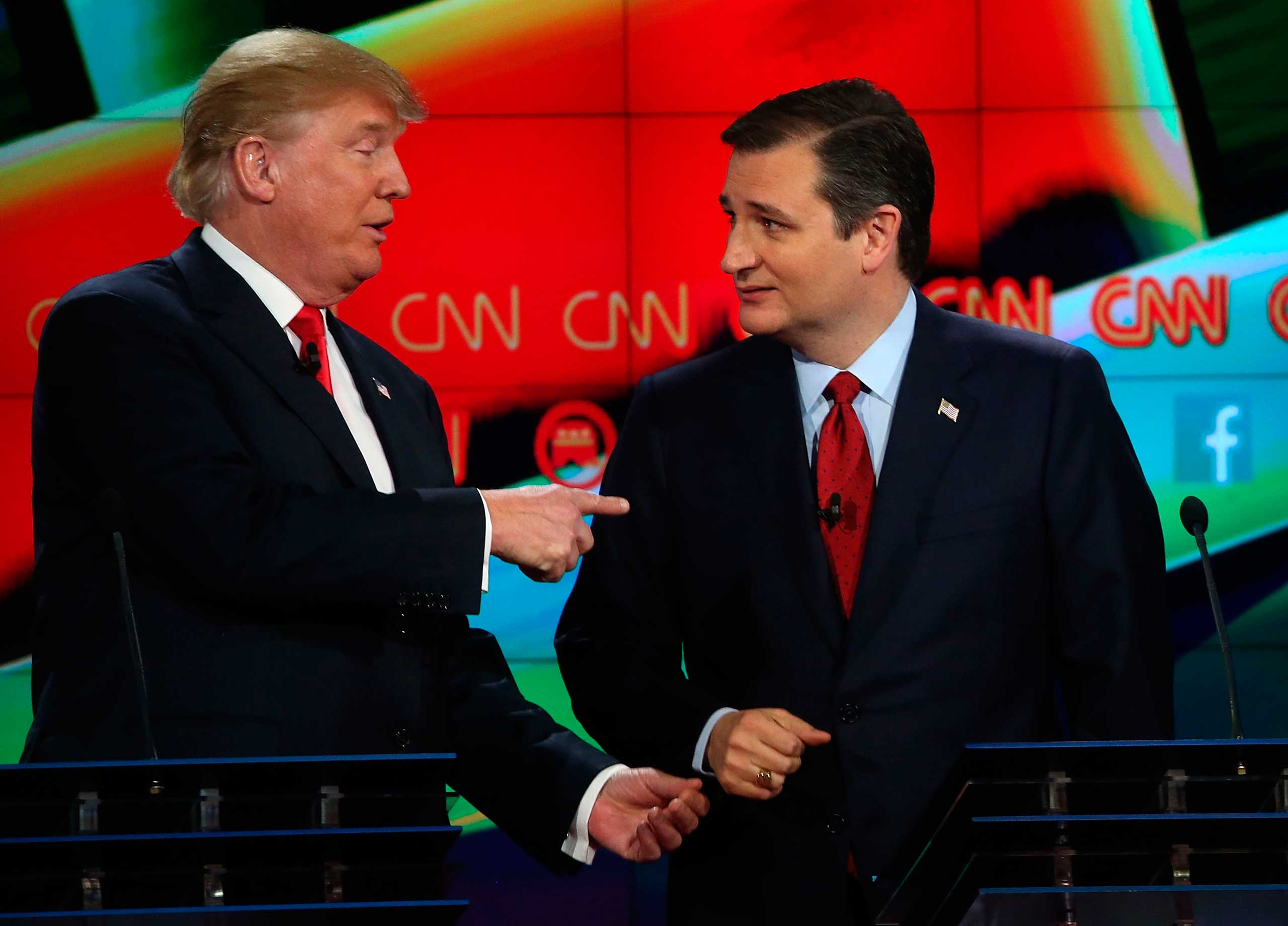 Republican presidential candidates Donald Trump and Sen. Ted Cruz (R-TX) interact at the conclusion of CNN's GOP presidential debate at The Venetian Las Vegas on Dec. 15, 2015.