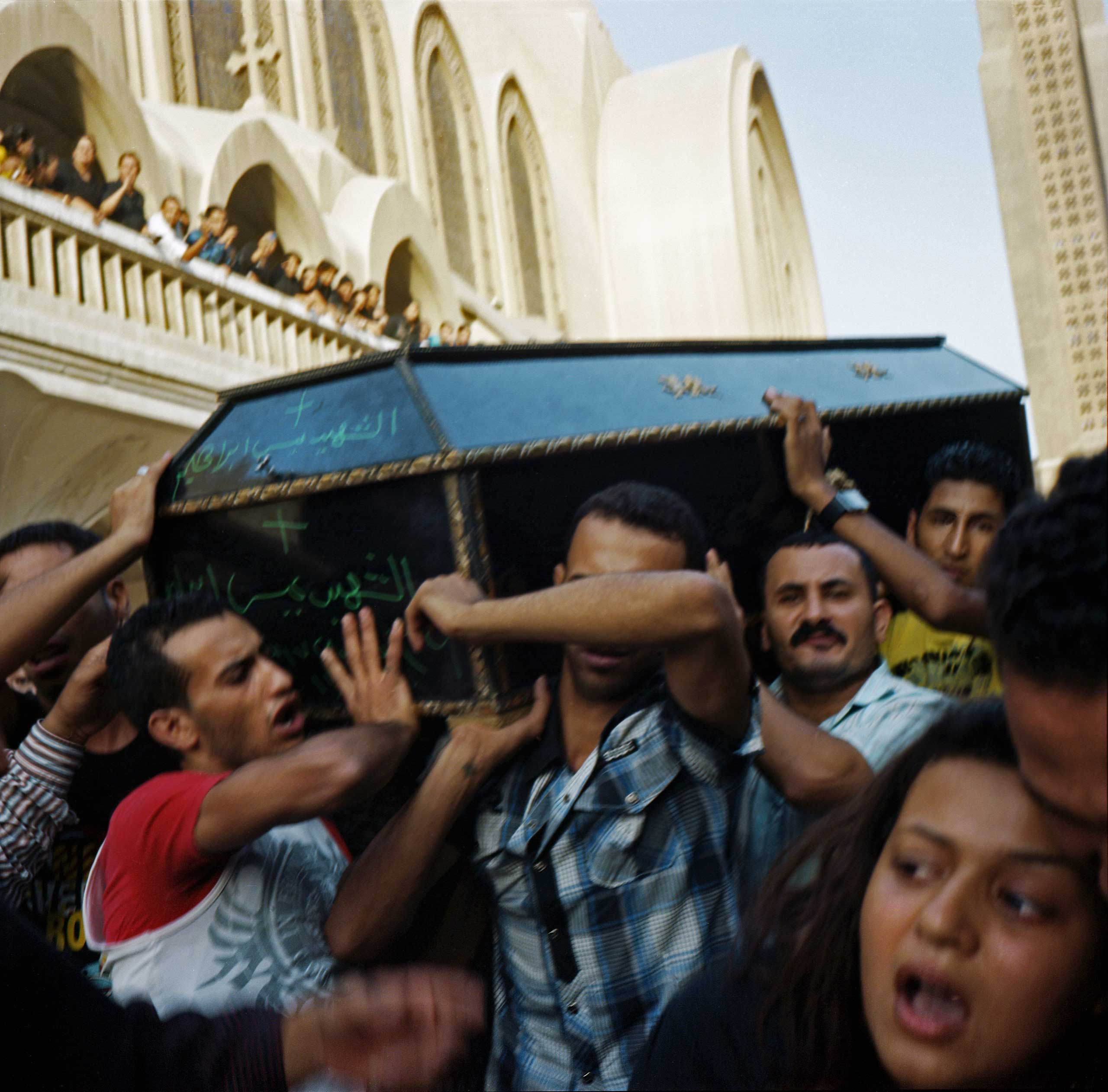 Relatives of victims carrying coffins out of the Abasseya Cathedral to be buried following violence that took place in front of Maspero TV building resulting in 28 mostly Coptic deaths and 212 injured. Oct., 2011