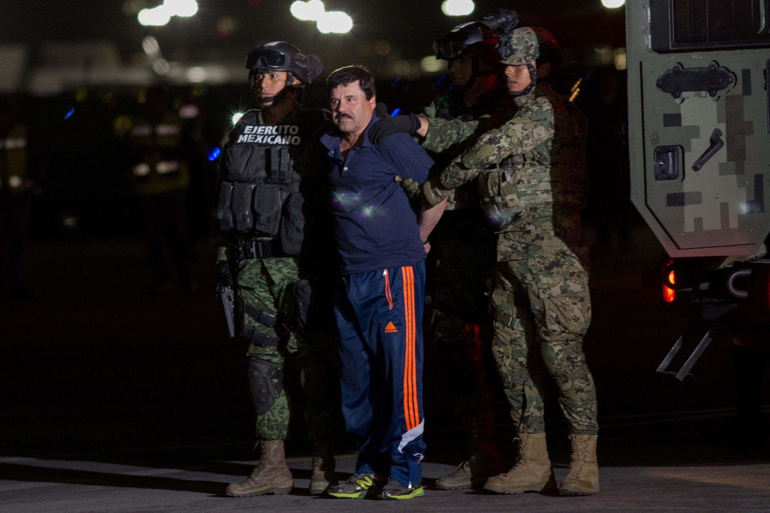Mexican soldiers escort Joaquín Guzmán upon his arrival in Mexico City after his arrest on Jan.8
