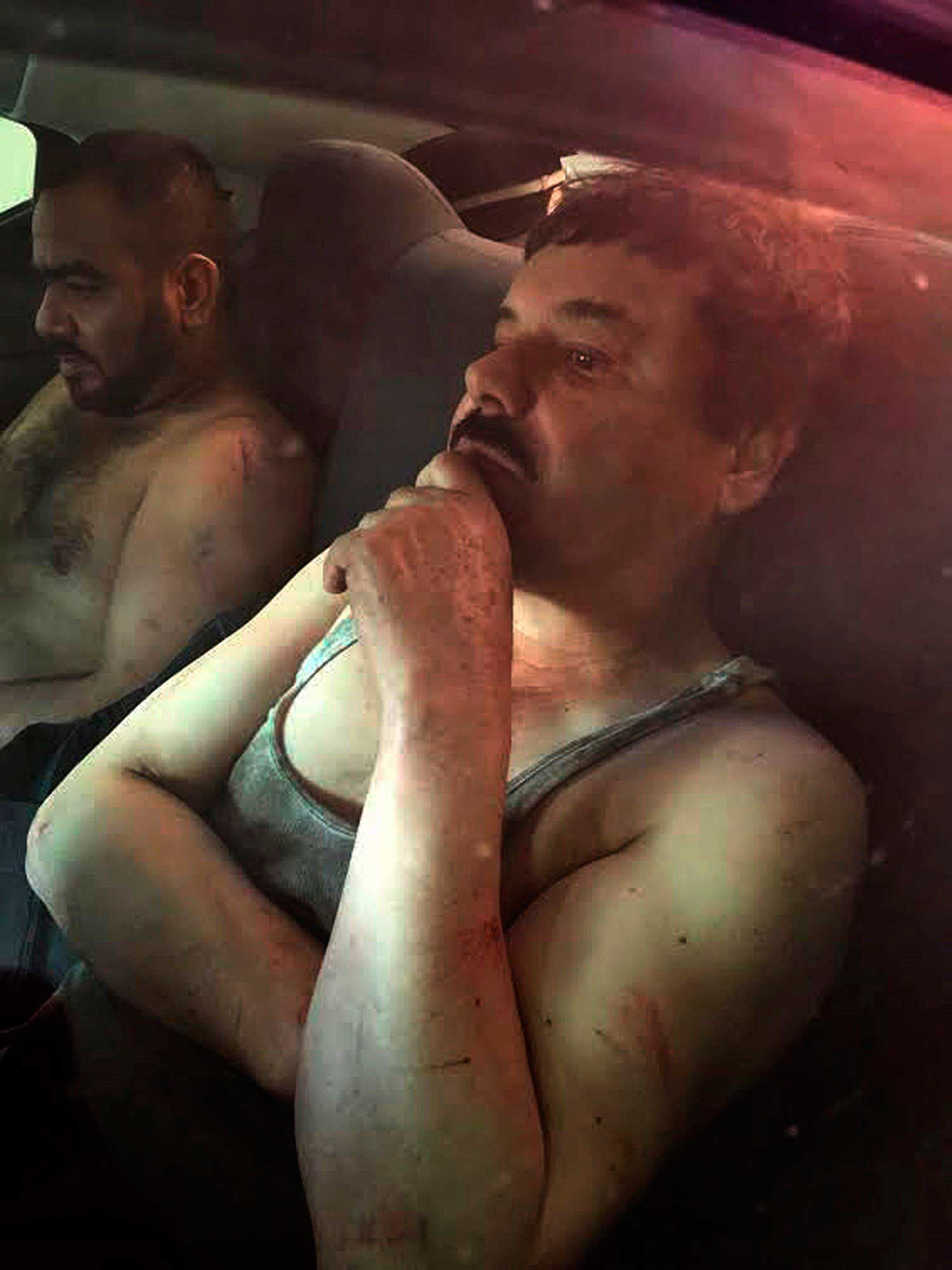A picture released by Mexican web site  Plaza de Armas  of Joaquín  El Chapo  Guzman in a vehicle after he was recaptured in the city of Los Mochis, Mexico, Jan. 8, 2016.