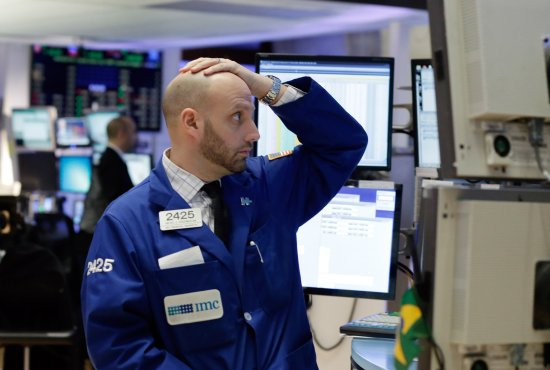 Specialist Meric Greenbaum works on the floor of the New York Stock Exchange, Monday, Jan. 4, 2016. U.S. stocks are opening 2016 on a grim note, dropping sharply after a plunge in China and declines in Europe.