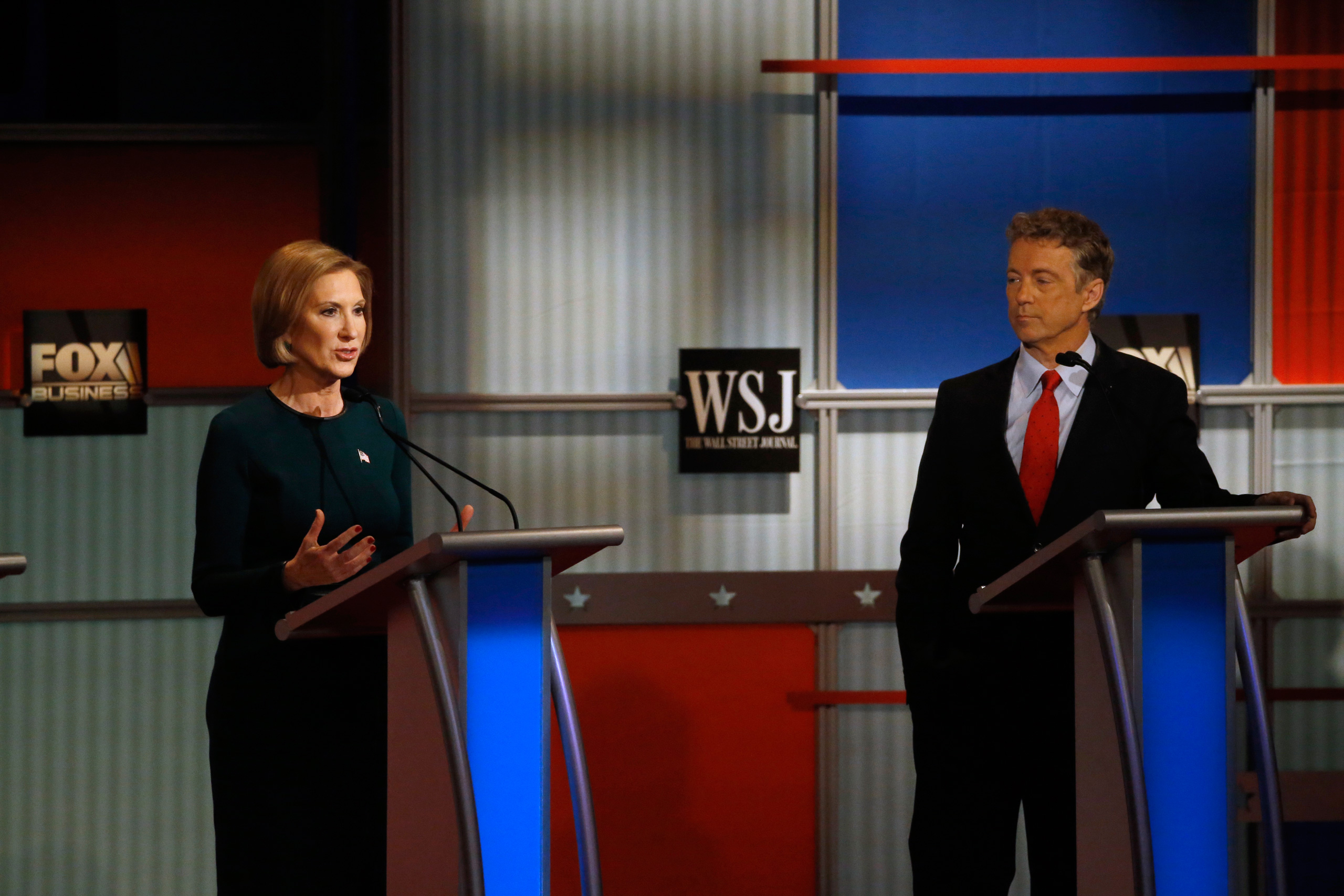 Carly Fiorina speaks as Rand Paul listens during the Republican presidential debate at the Milwaukee Theatre in Milwaukee on Nov. 11, 2015.