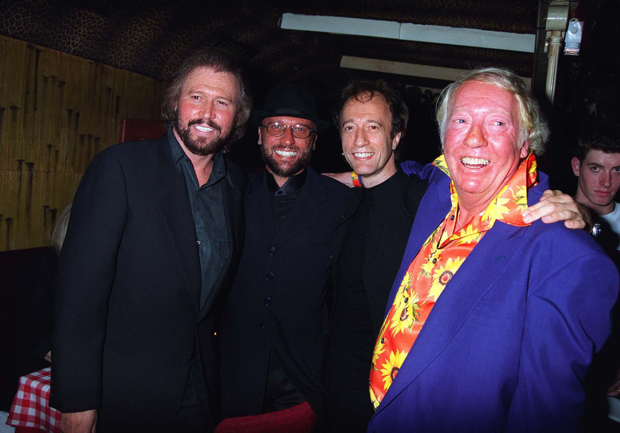 Barry, Maurice and Robin Gibb with Robert Stigwood at Barry Gibb's 50th Birthday In London in 1996