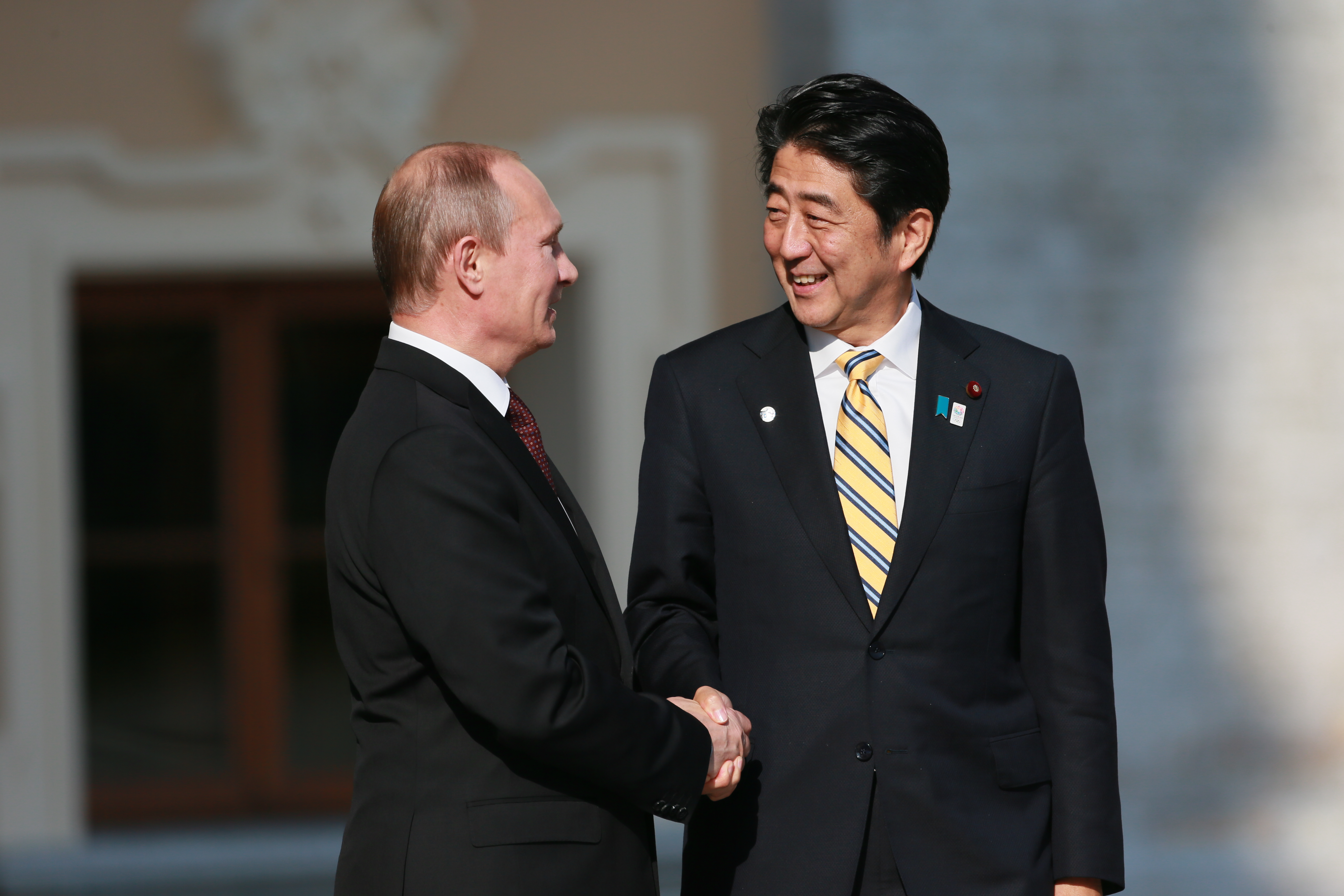 Russian President Vladimir Putin, left, greets Japanese Prime Minister Shinzo Abe at the G-20 summit on Sept. 5, 2013, in St. Petersburg