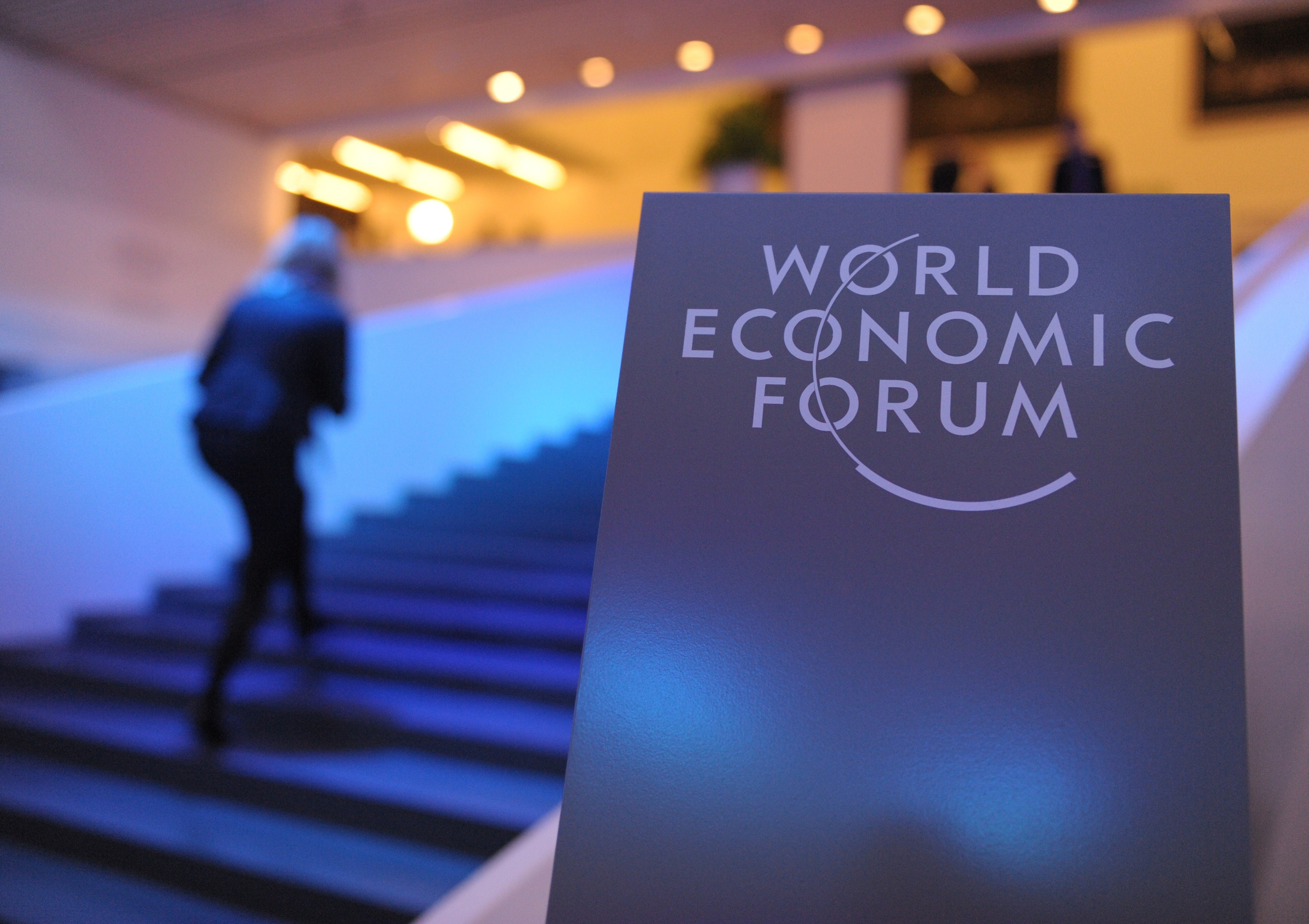 Participants arrive at the congress centrre prior to the opening of the World Economic Forum in Davos on January 21, 2014.