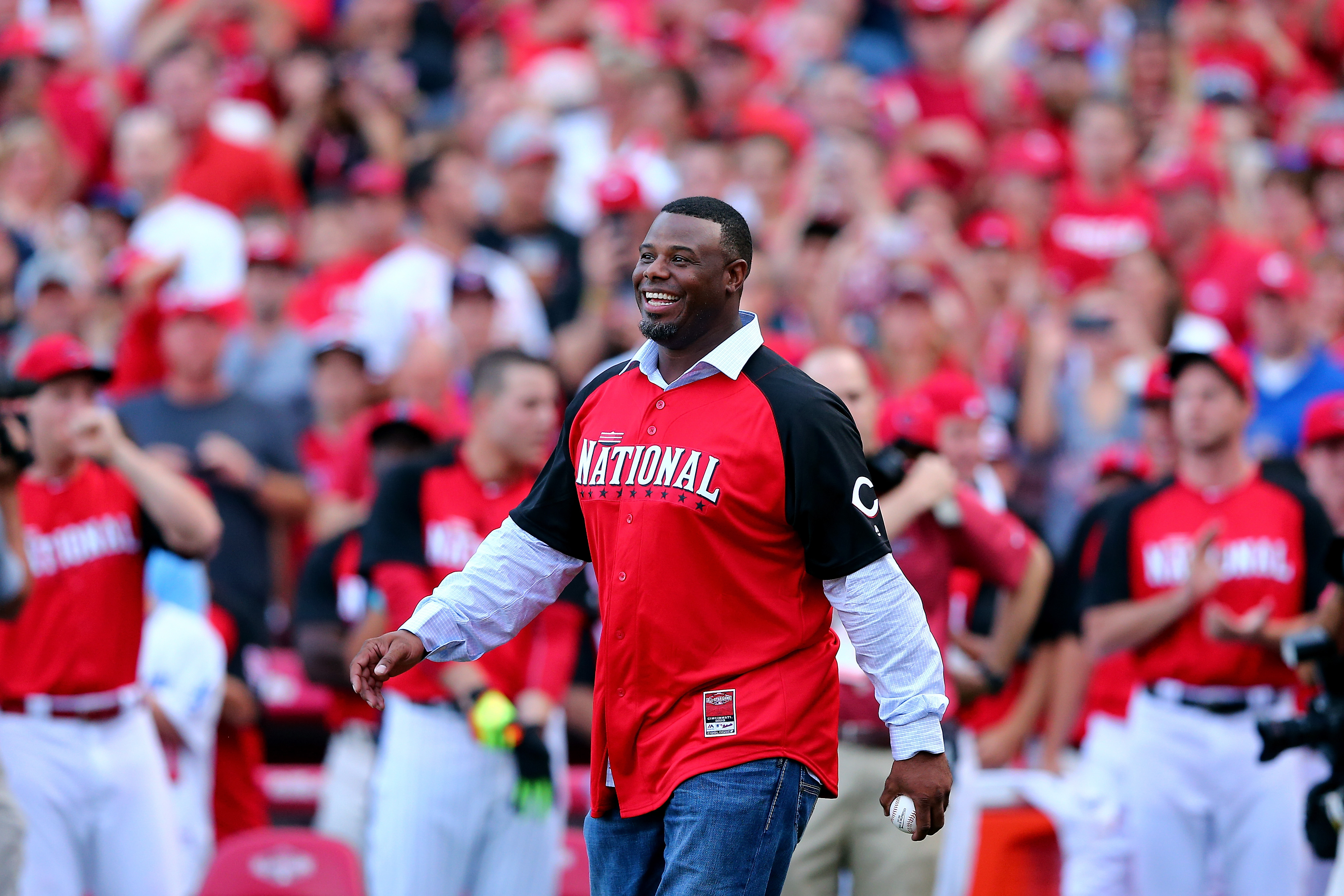 Ken Griffey Jr. walks out to throw the first pitch prior to the Gillette Home Run Derby presented by Head & Shoulders at the Great American Ball Park in Cincinnati on July 13, 2015.