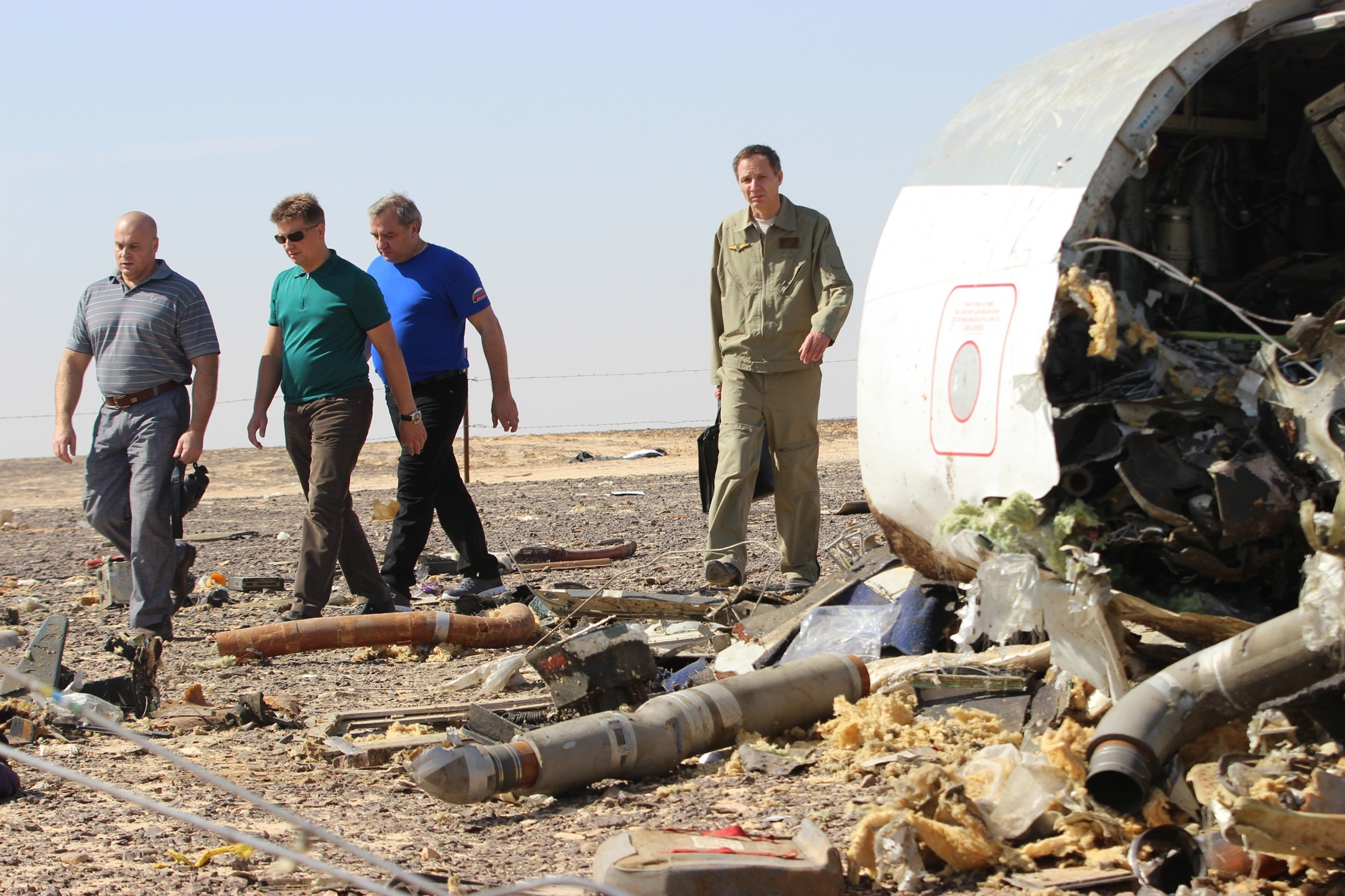 Russian Minister of Emergency Situations Vladimir Puchkov (3rd L) inspect the crash site of Russian Airliner in Suez, Egypt on November 01, 2015.