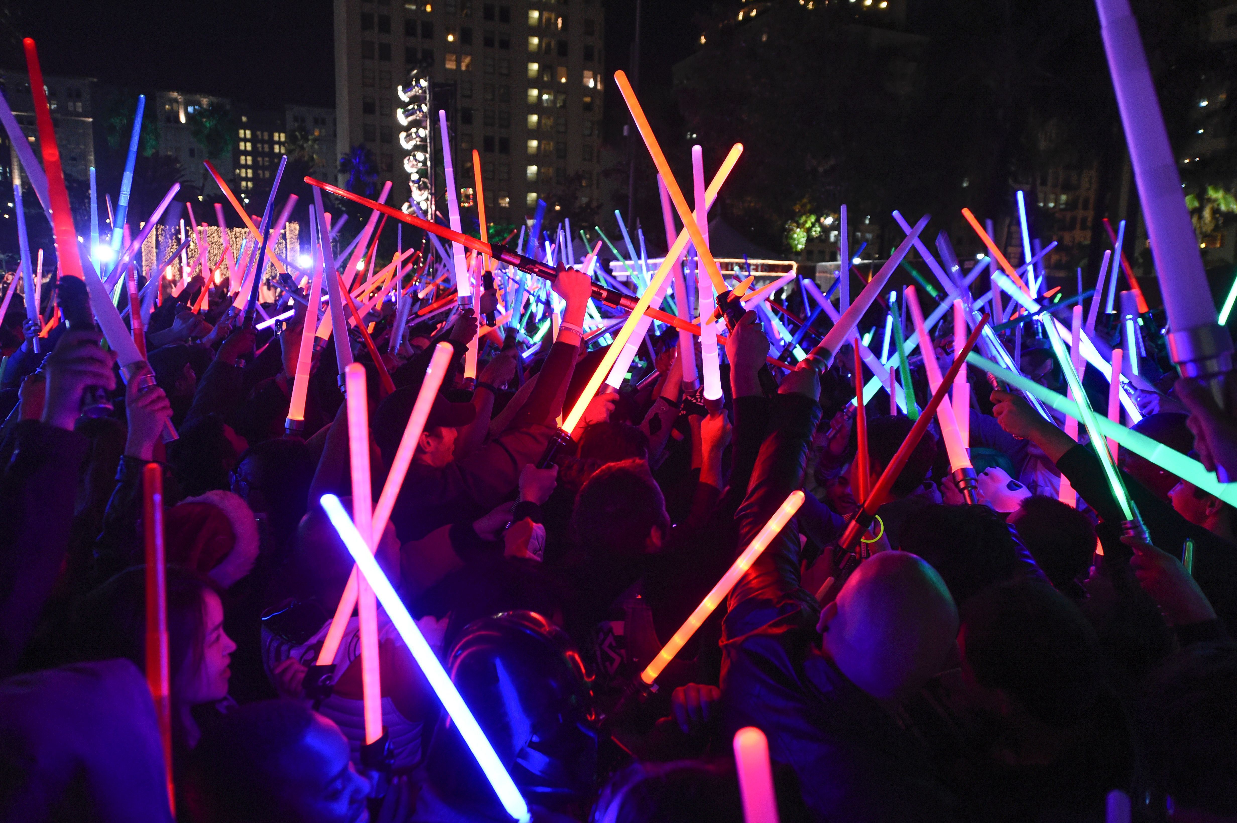 'Star Wars' fans raise their lightsabers in Pershing Square in downtown Los Angeles, Calif., on Dec. 18, 2015.
