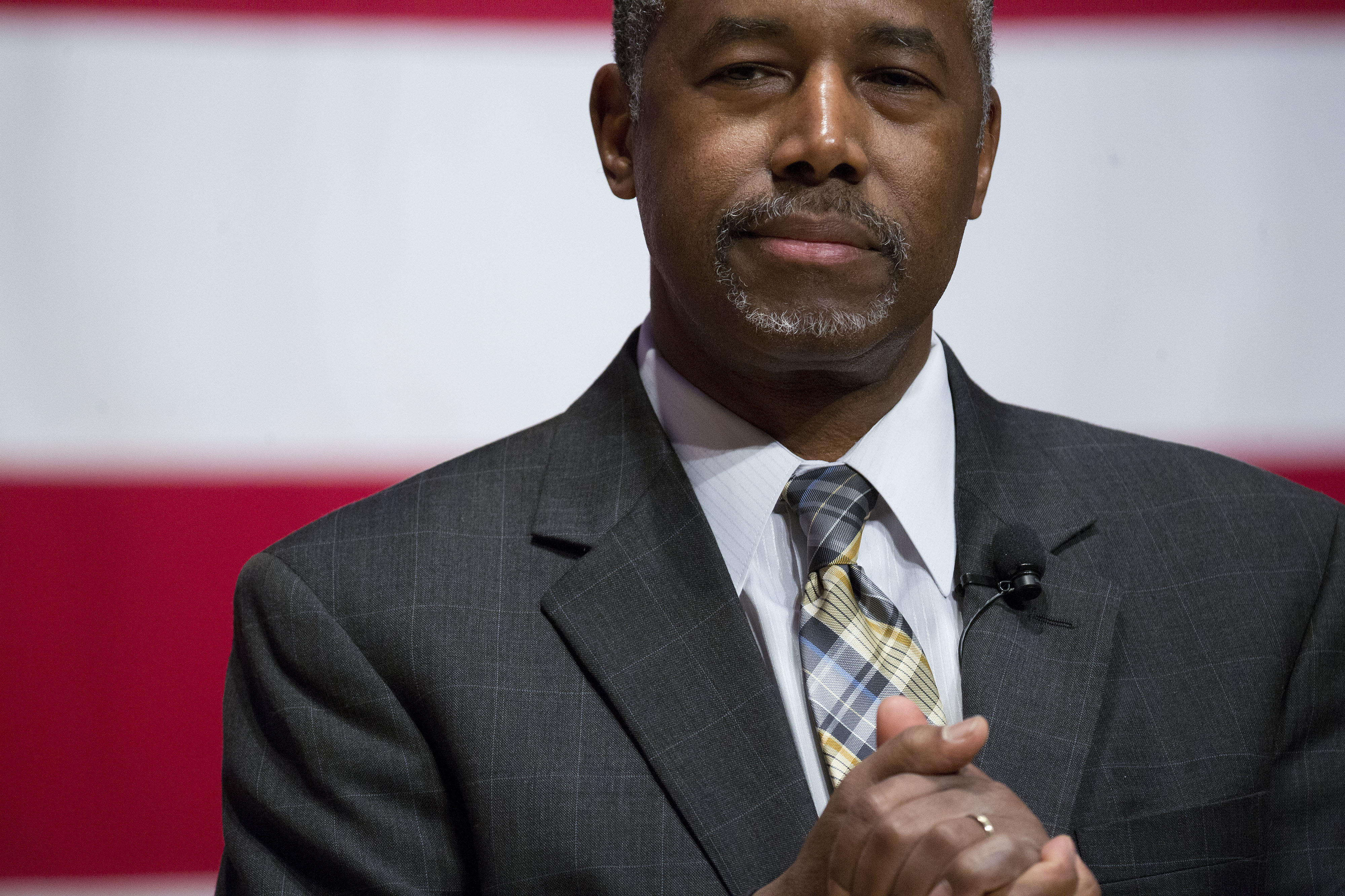 Ben Carson listens to a question during a town hall meeting at Nashua Community College in Nashua, New Hampshire, U.S., on Sunday, Dec. 20, 2015.