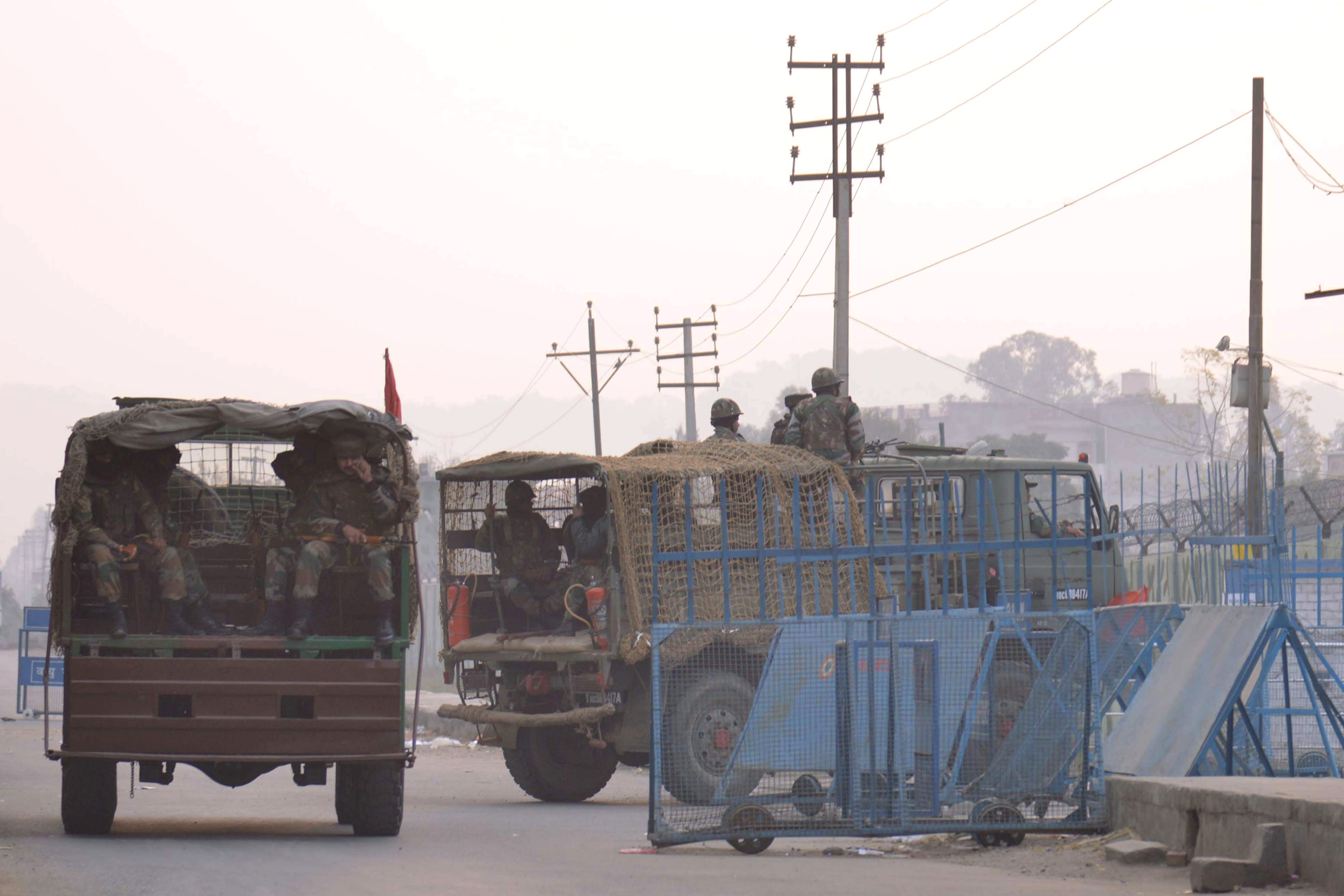 Indian army trucks transport troops to the air-force base in Pathankot on Jan. 4, 2016, after a weekend of fierce fighting with suspected Islamic insurgents, in which seven soldiers and five attackers were killed