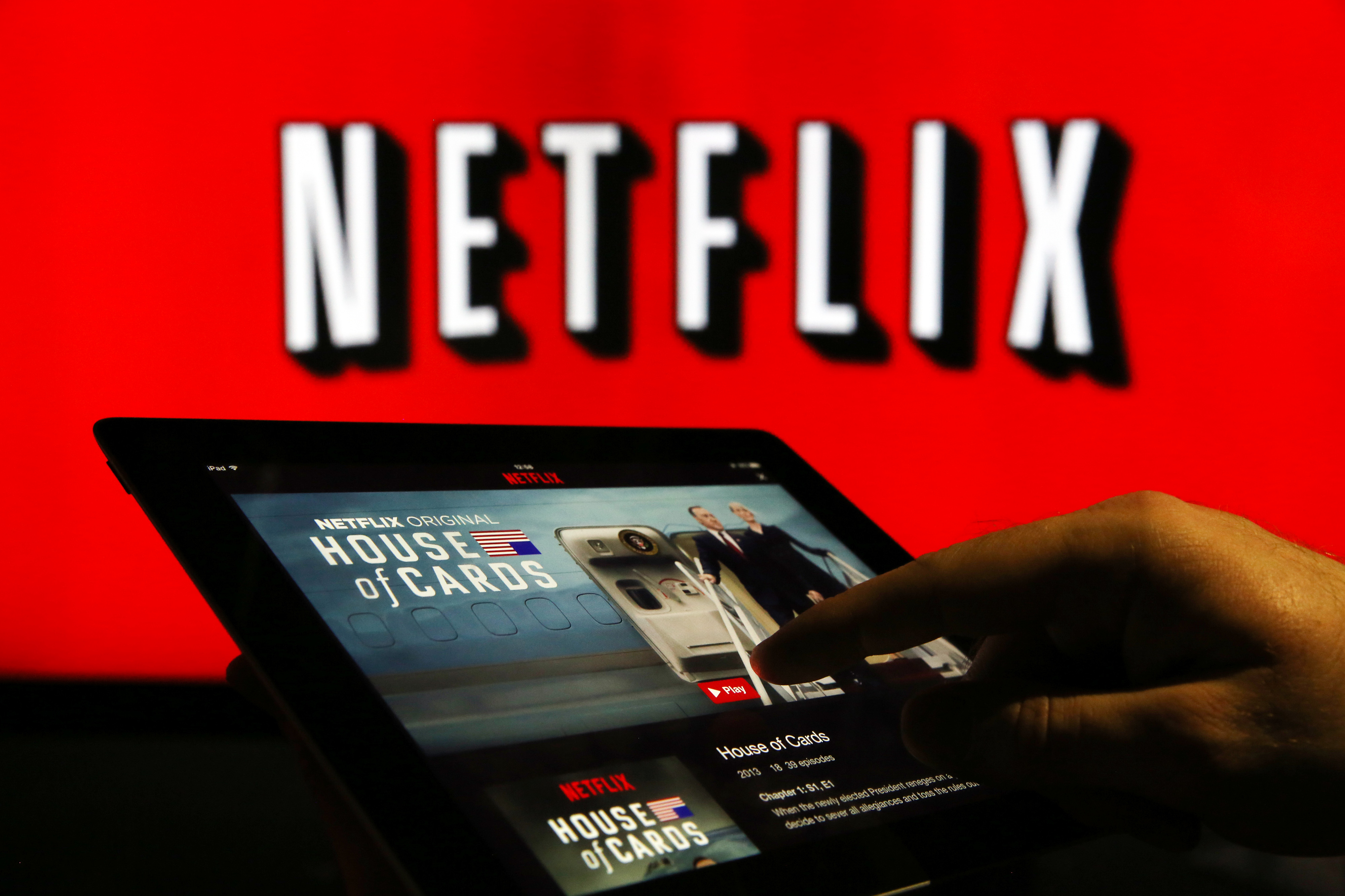 A man prepares to watch House Of Cards on the Netflix Inc. application on a tablet device in London on Jan. 5, 2016.