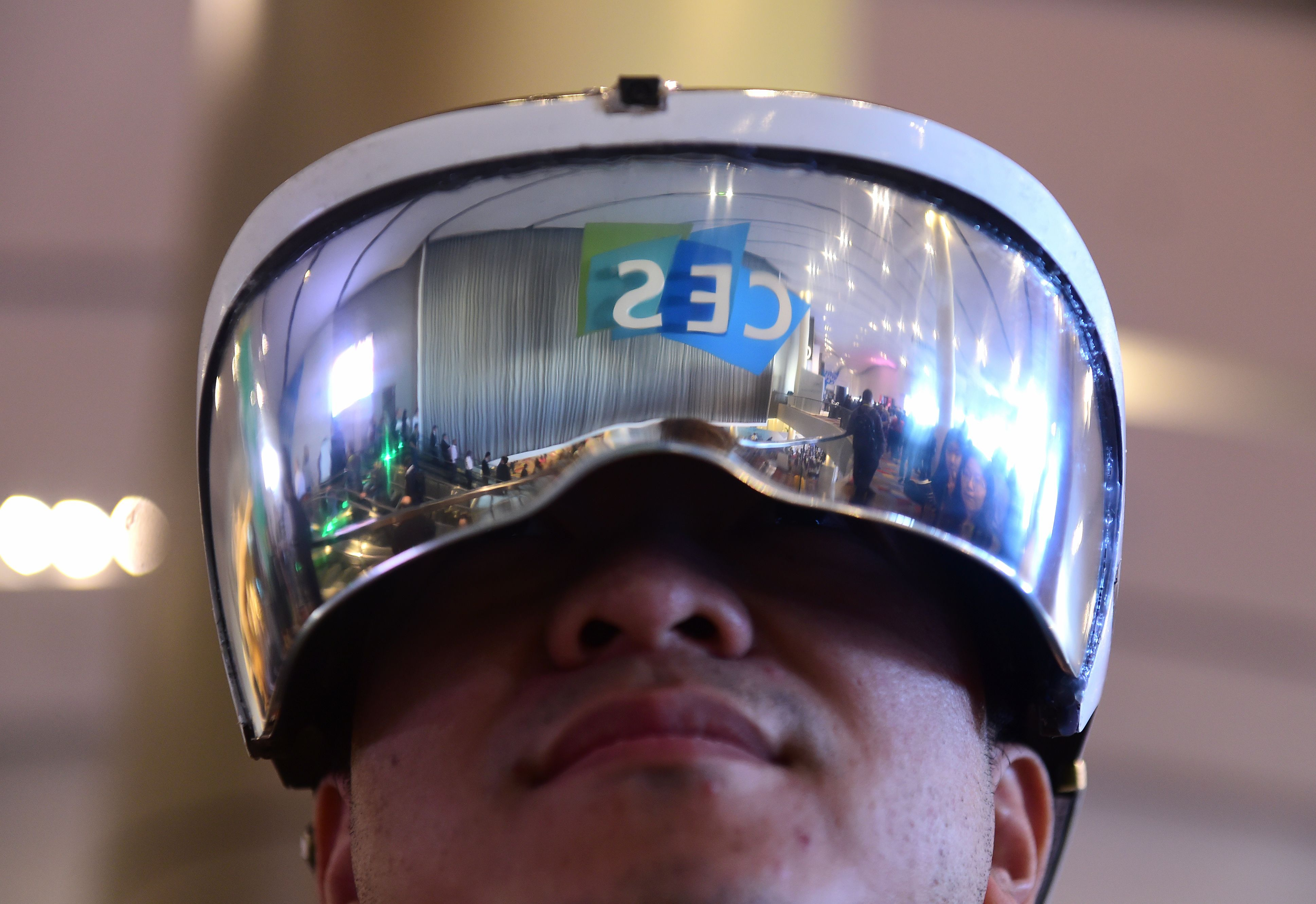 Attendee Wei Rongjie wears a working prototype of his HoloSeer AR/VR all-in-one agumented reality and virtual reality headseat, January 6, 2016 at the CES 2016 Consumer Electronics Show in Las Vegas, Nevada.
