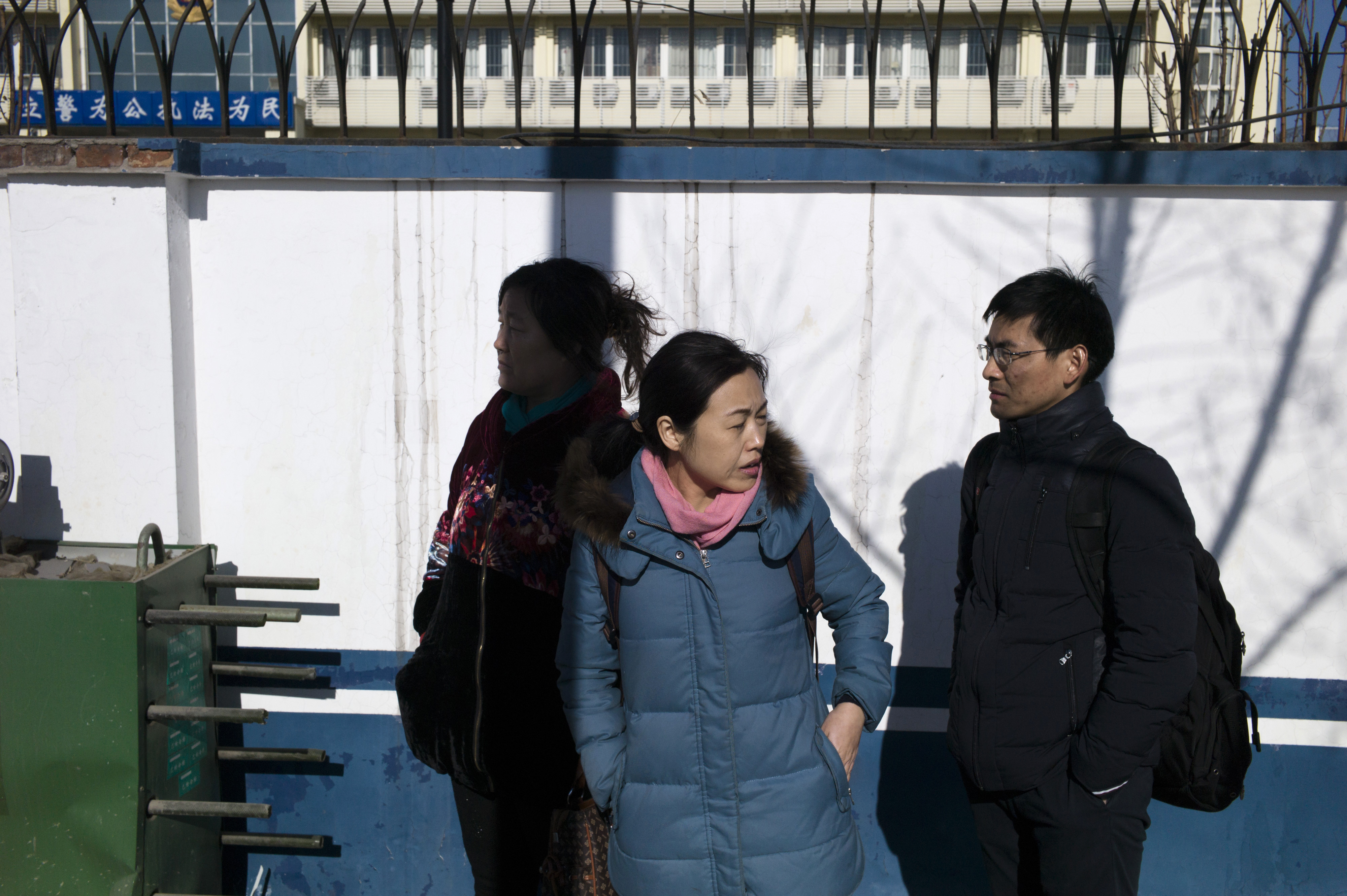 Family members and lawyers of detained lawyers and their colleagues gather after another attempt to seek answers at the Hexi District Detention Center in Tianjin on Jan. 8, 2016