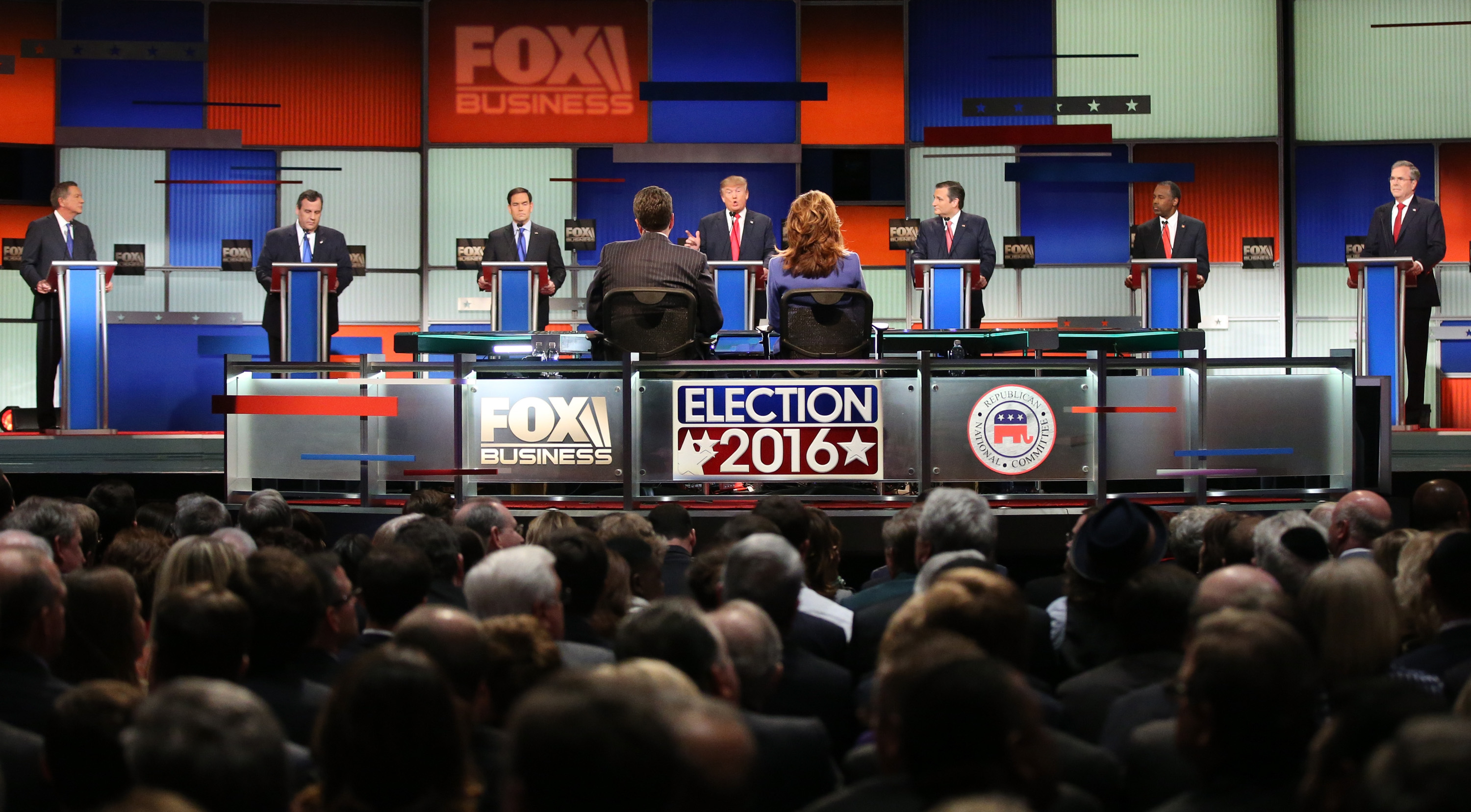 Republican presidential candidates (L-R) Ohio Governor John Kasich, New Jersey Governor Chris Christie, Sen. Marco Rubio (R-FL), Donald Trump, Sen. Ted Cruz (R-TX), Ben Carson and Jeb Bush participate in the Fox Business Network Republican presidential debate at the North Charleston Coliseum and Performing Arts Center on January 14, 2016 in North Charleston, South Carolina. The sixth Republican debate is held in two parts, one main debate for the top seven candidates, and another for three other candidates lower in the current polls.