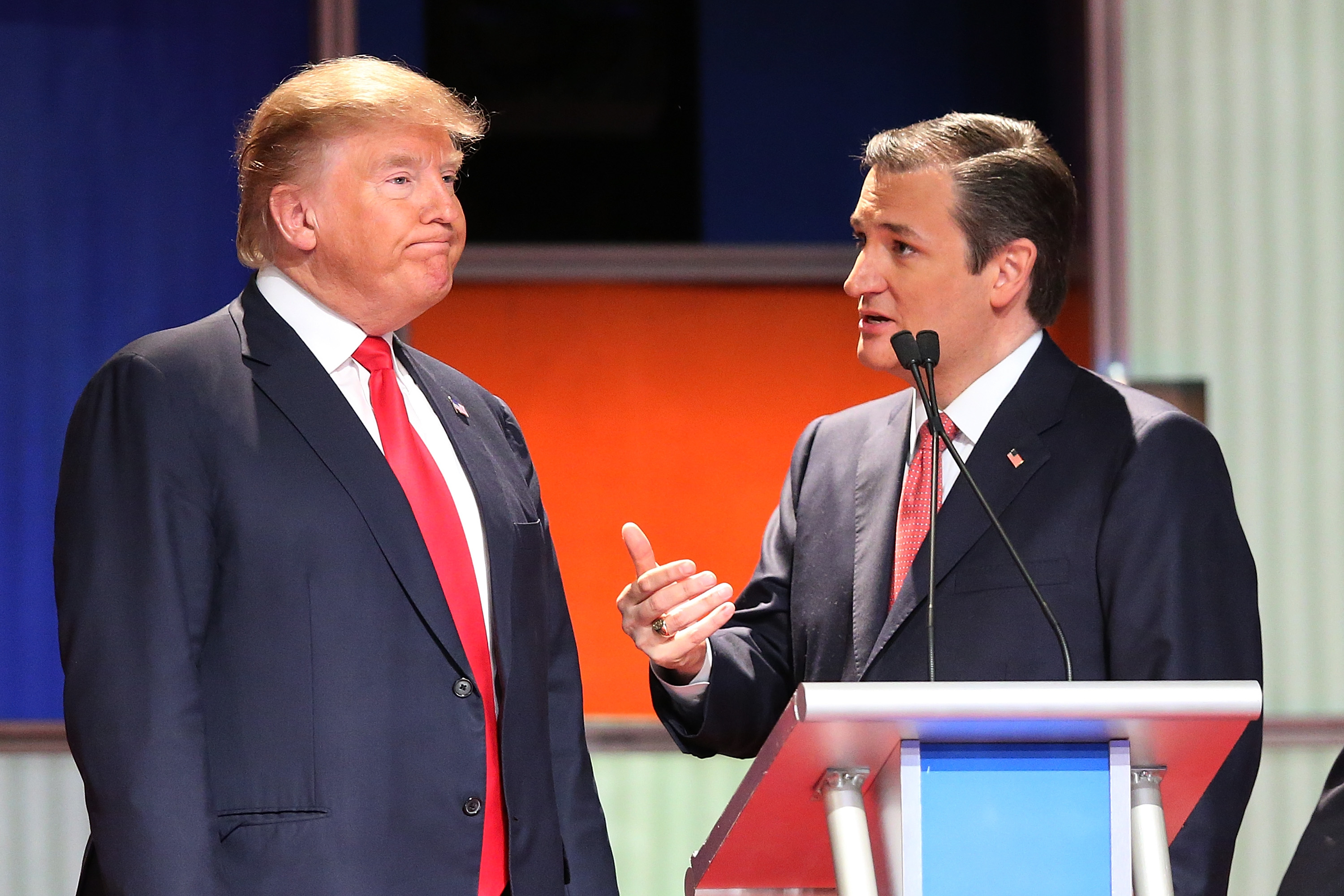 Republican presidential candidates (L-R) Donald Trump and Sen. Ted Cruz (R-TX) speak during a commercial break in the Fox Business Network Republican presidential debate at the North Charleston Coliseum and Performing Arts Center on January 14, 2016 in North Charleston, South Carolina.