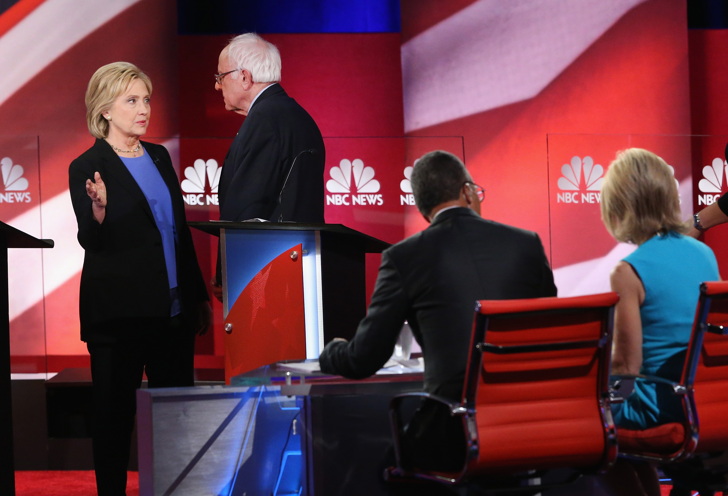 Democratic presidential candidates Hillary Clinton and Senator Bernie Sanders chat following the Democratic Candidates Debate hosted by NBC News and YouTube on Jan. 17, 2016 in Charleston, South Carolina. T