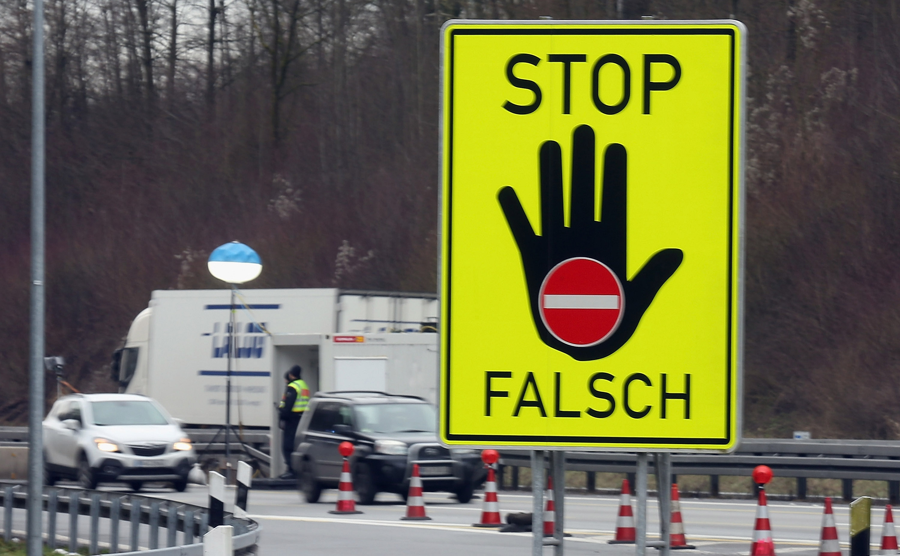 German federal police control cars on the A3 highway near the border to Austria on a section used by arriving migrants and refugees on Jan. 28, 2016, near Passau, Germany