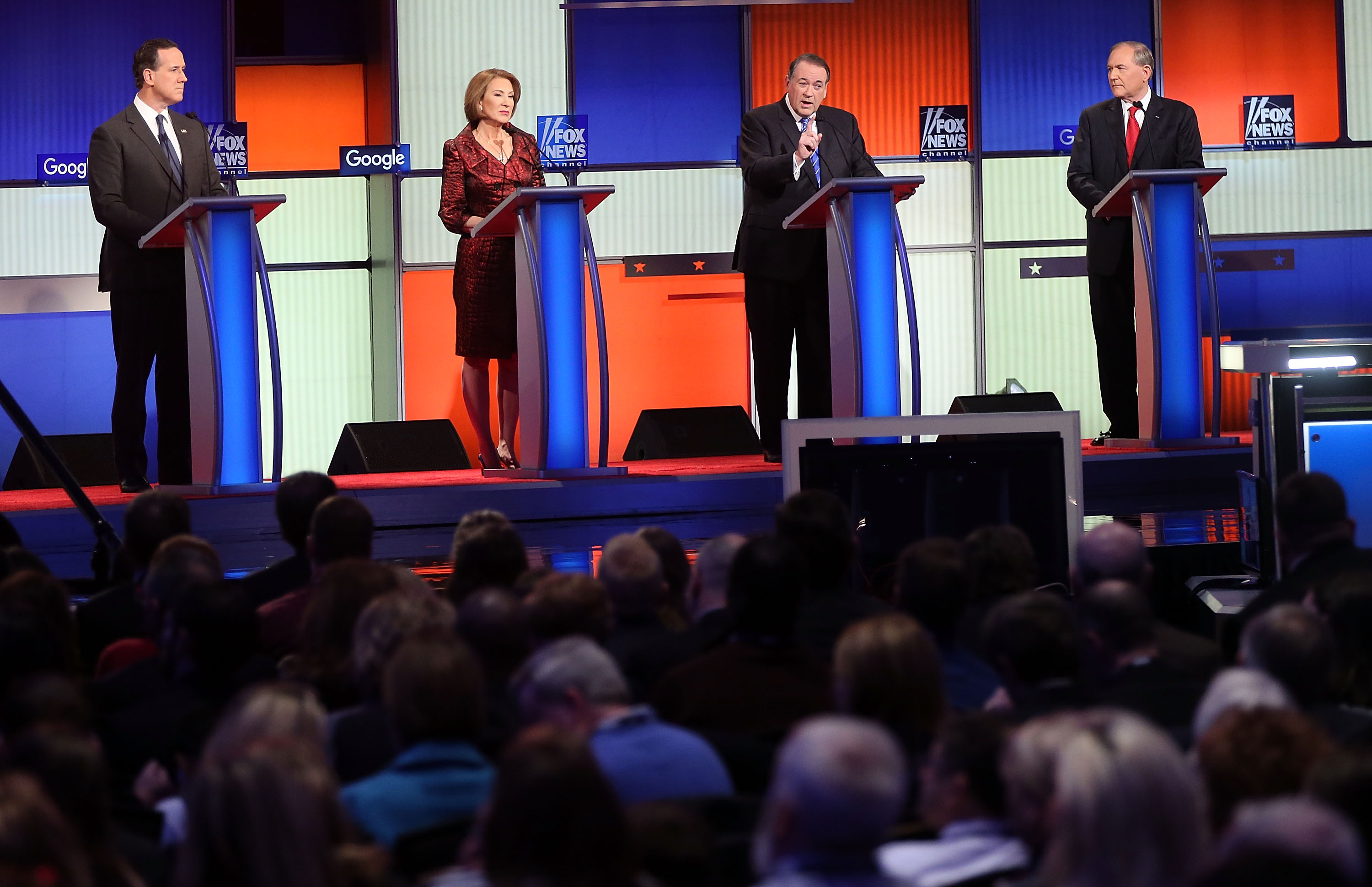 Republican presidential candidates (L-R) Rick Santorum, Carly Fiorina, Mike Huckabee and Jim Gilmore participate in the Fox News - Google GOP Debate January 28, 2016 at the Iowa Events Center in Des Moines, Iowa. Residents of Iowa will vote for the Republican nominee at the caucuses on February 1.