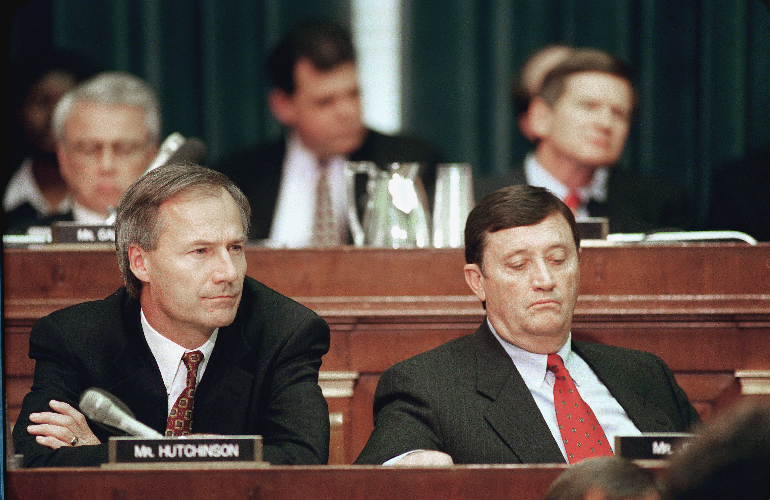 Asa Hutchinson,R-Ark., and Bill Jenkins,R-Tenn.,listen to Independent Counsel Kenneth Starr opening statement before the House Judiciary Committee regarding articles of impeachment against President Bill Clinton.  ( Scott J. Ferrell--Congressional Quarterly/Getty Images)