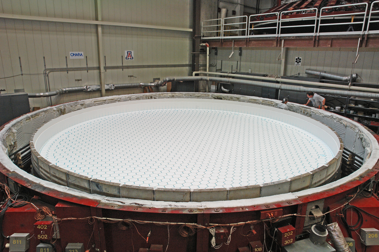 Mold for casting an 8.4-meter honeycomb mirror for the GMT. The glass will melt around the hexagonal boxes to form the honeycomb.