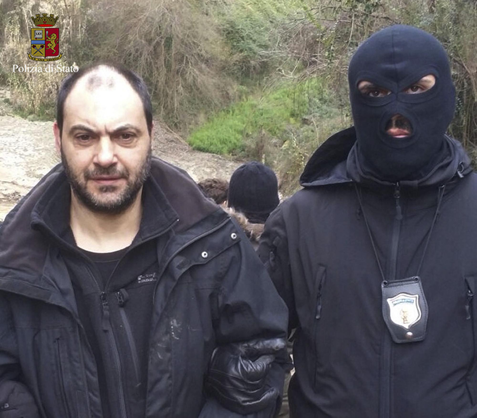 Giuseppe Ferraro is taken into custody after he was arrested in a bunker, on Jan. 29, 2016.