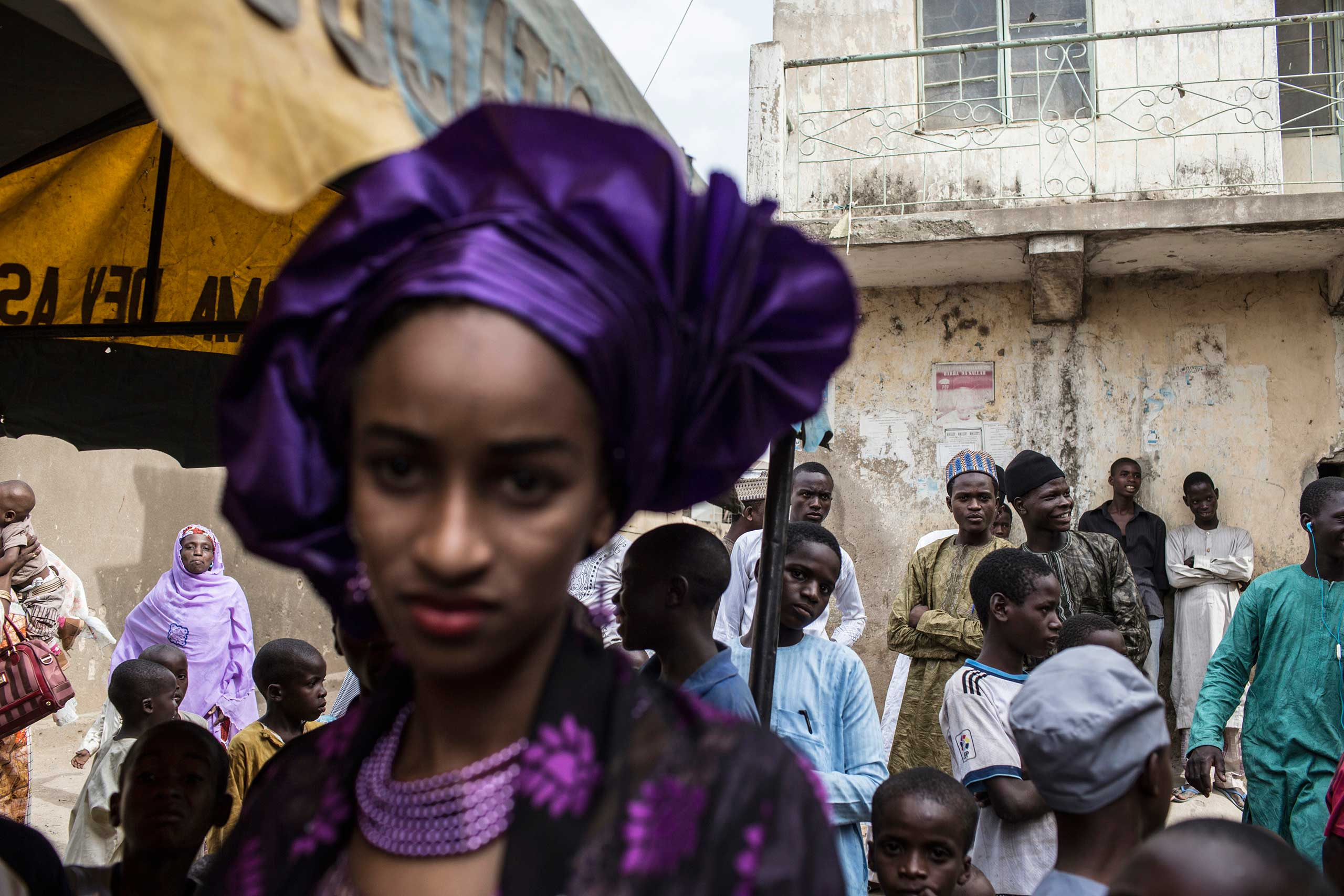 A bride at a wedding stands apart from the guests, Kano, Northern Nigeria. April 7, 2013.