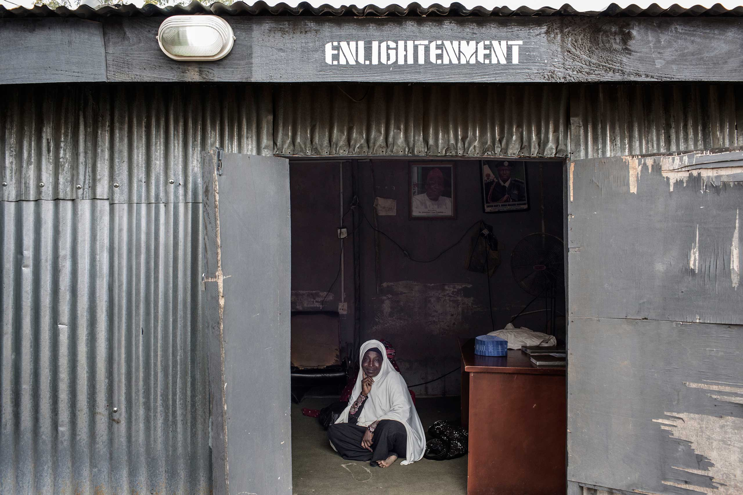 A woman poses for a portrait at the Office of Enlightenment at the Hisbah, the Islamic morality police, Kano, Northern Nigeria, Aug. 17, 2015.