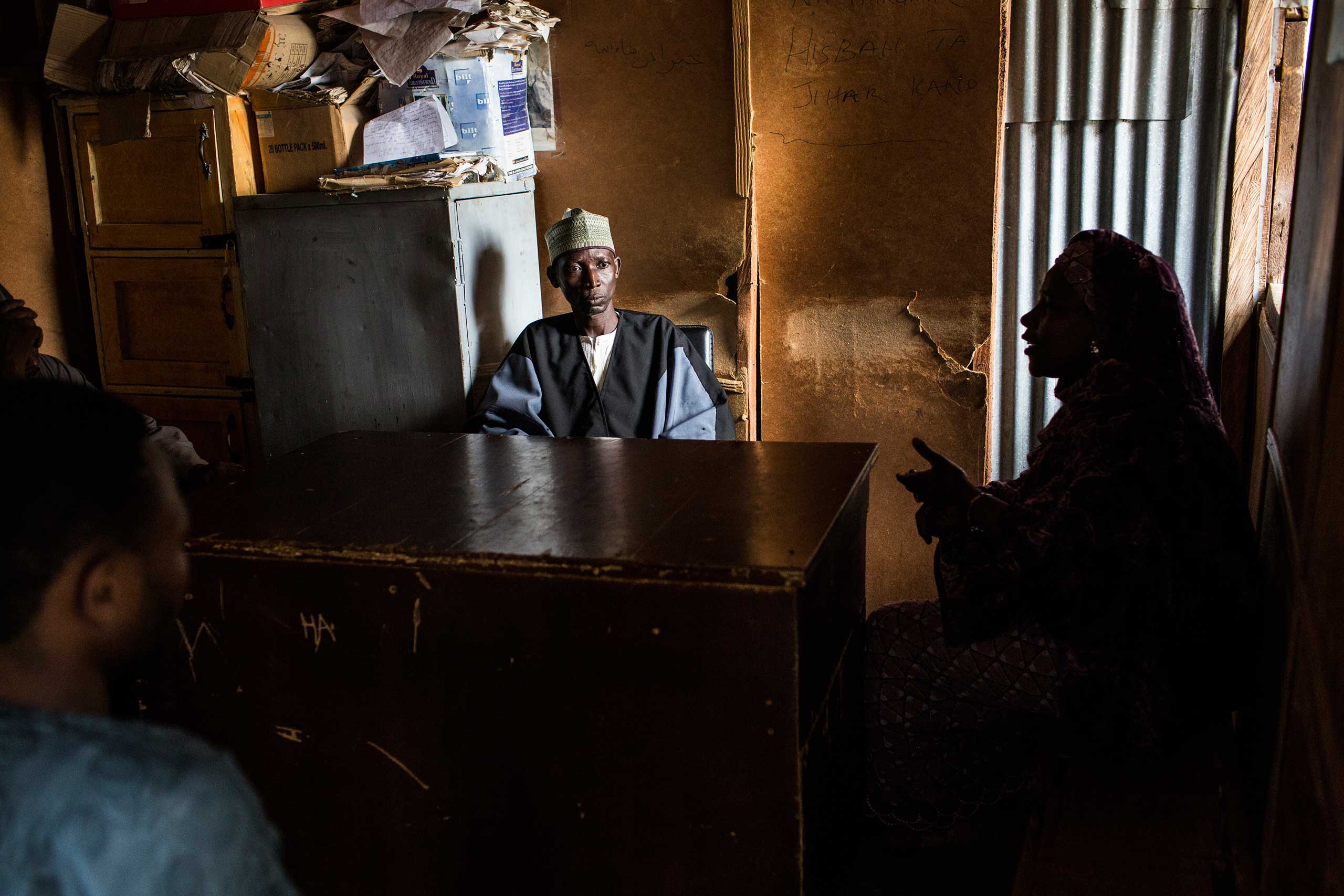 An officer of the Hisbah, adjudicates a family dispute in Kano, Northern Nigeria, Aug. 17, 2015.