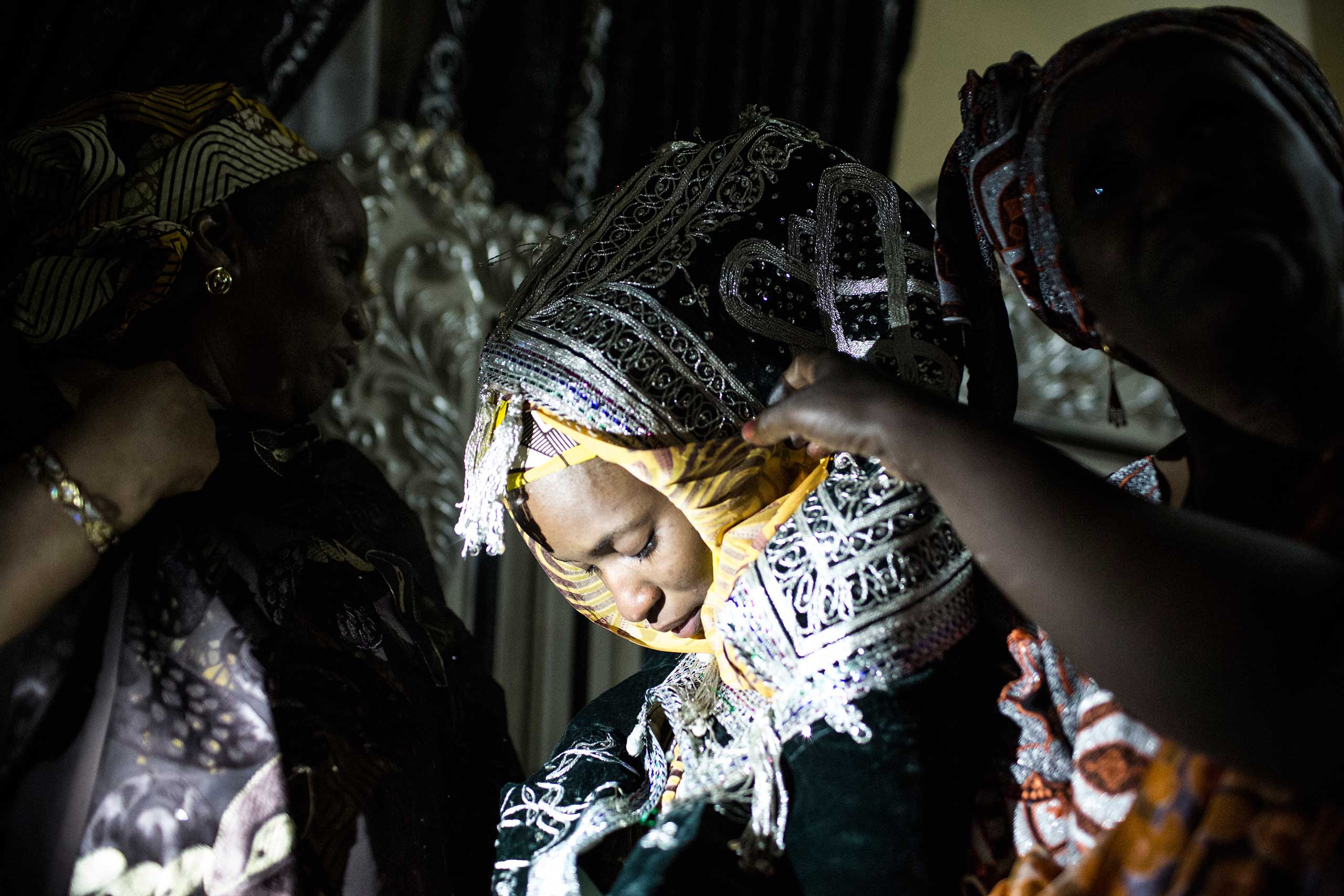 A bride is taken by her female relatives to her husband's home on the outskirts of Kano, Northern Nigeria, April 13, 2013.