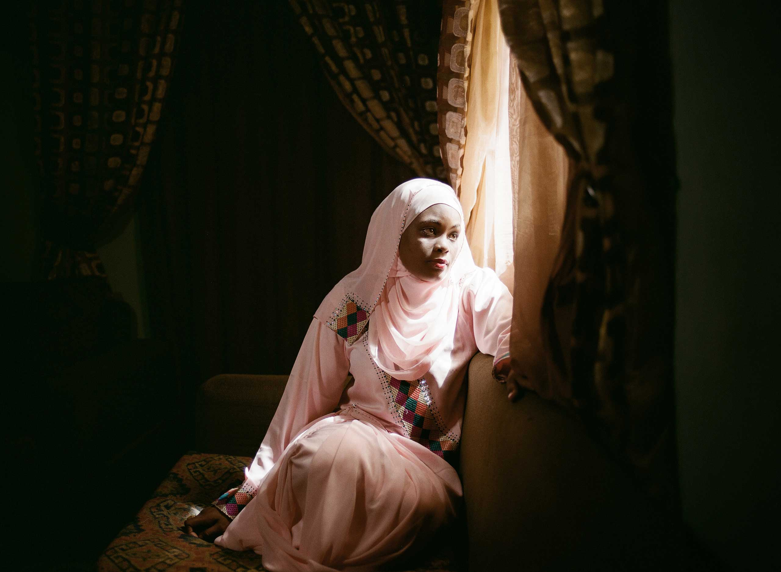 """Farida Ado, age 27, is a romance novelist,  one of a small but significant contingent of women in Northern Nigeria writing books called Littattafan soyayya, Hausa for """"love literature,"""" Kano ,April 15, 2013."""