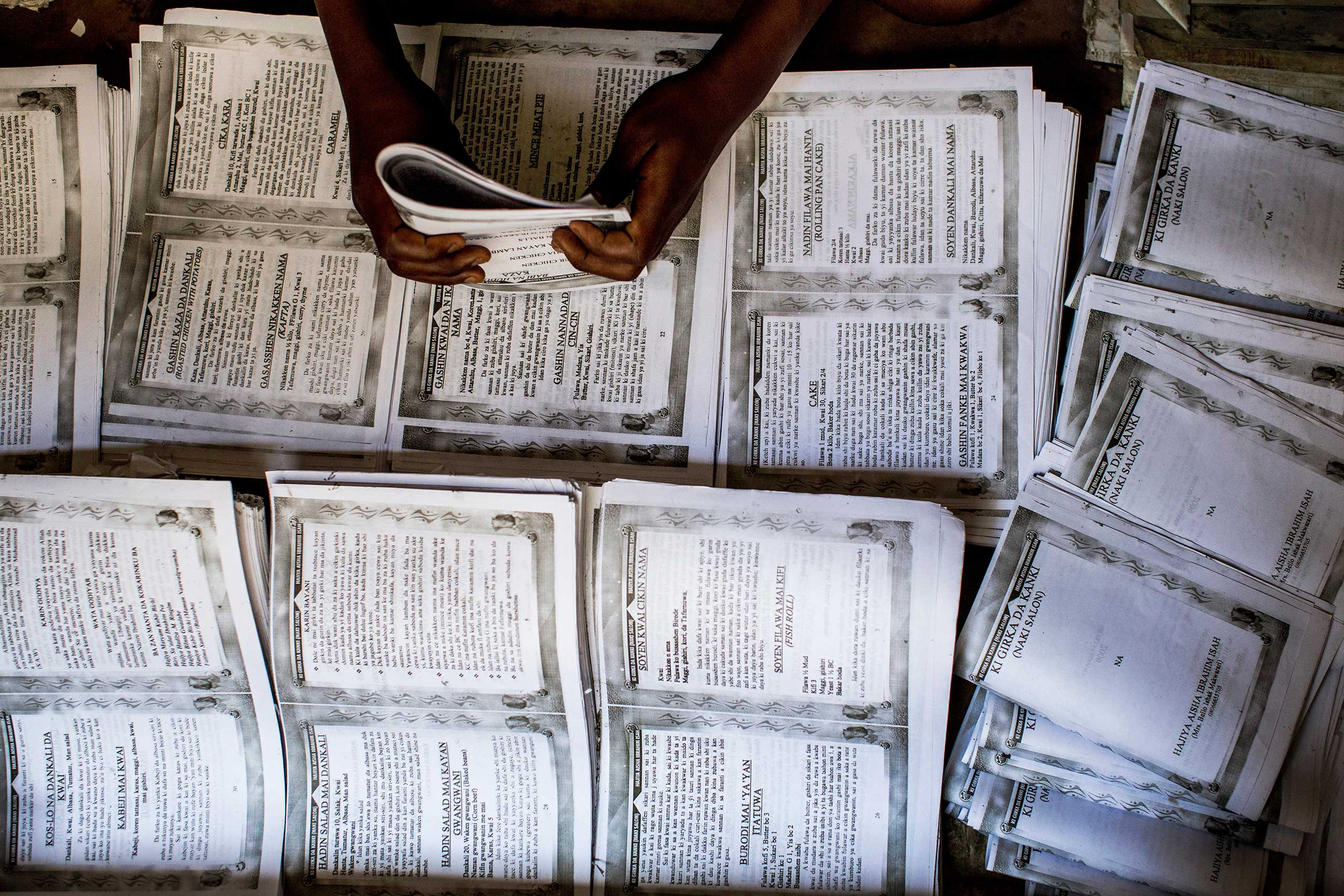 Novels and other books are put together by hand in Kano, Northern Nigeria, April 8, 2013.