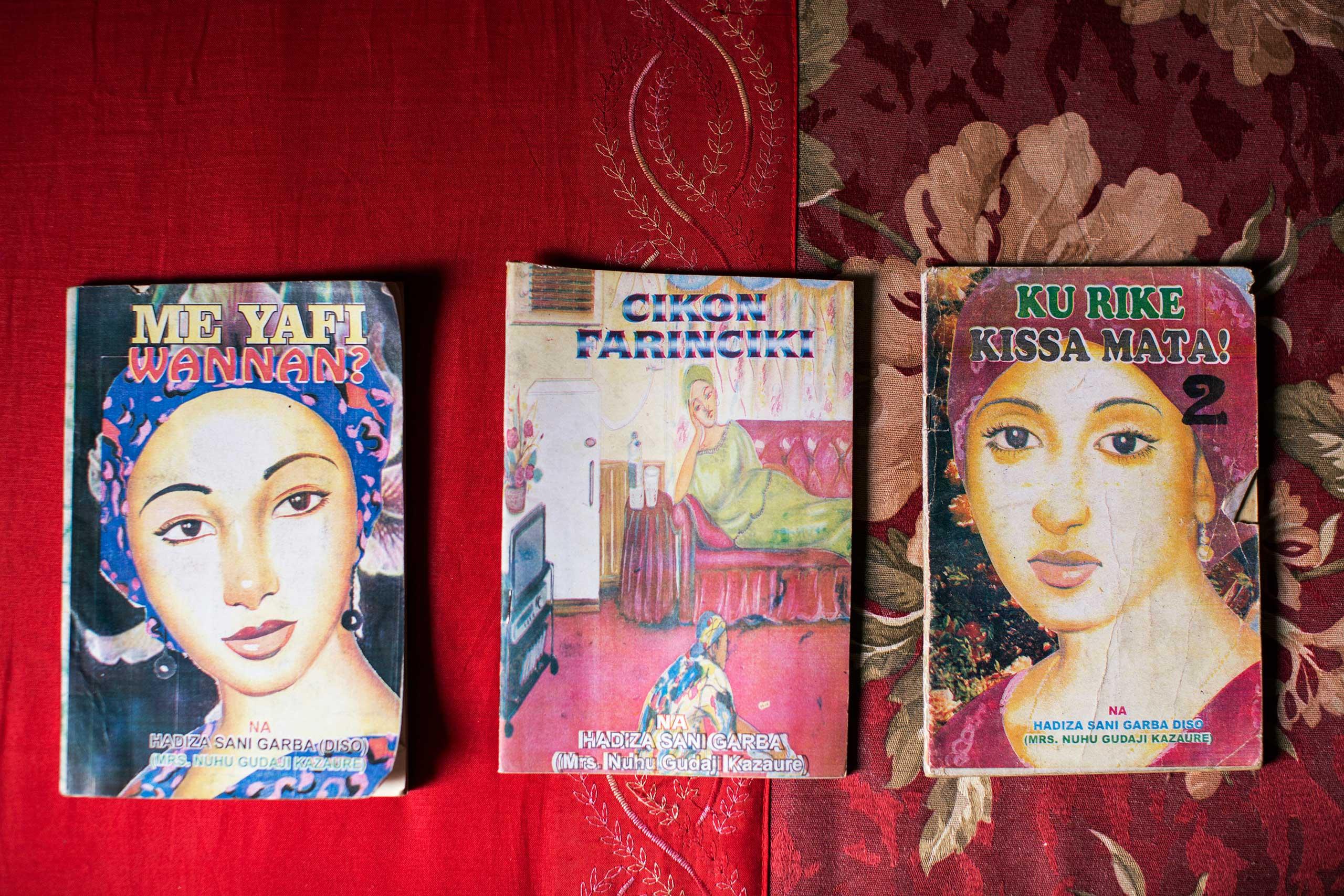 Three novels with hand drawn covers by Hadiza Garba, a popular novelist, Kano, Northern Nigeria, April 10, 2013.