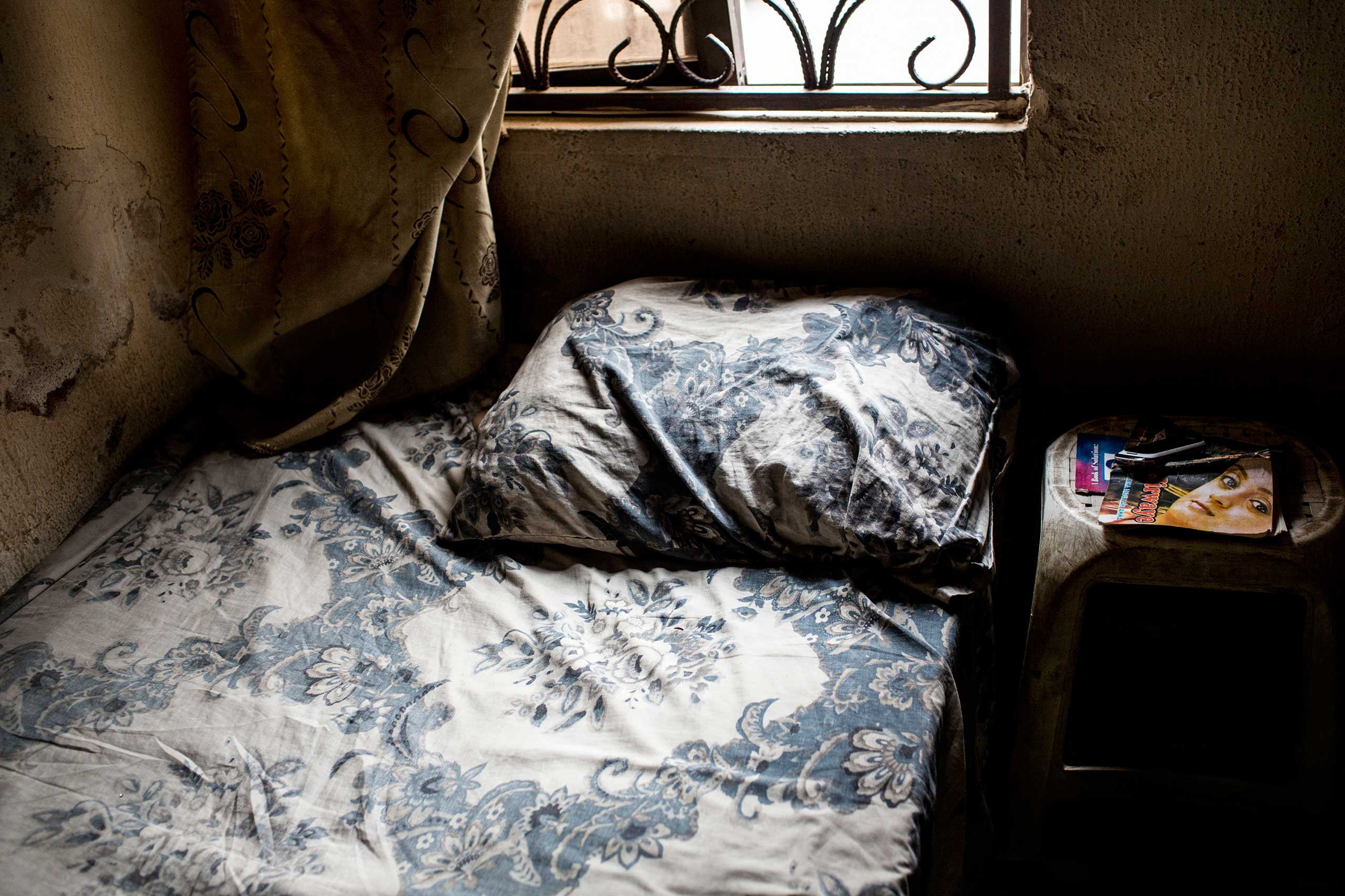 A novel sits on the bedside table of a young girl in Kano, Northern Nigeria, March 1, 2014.