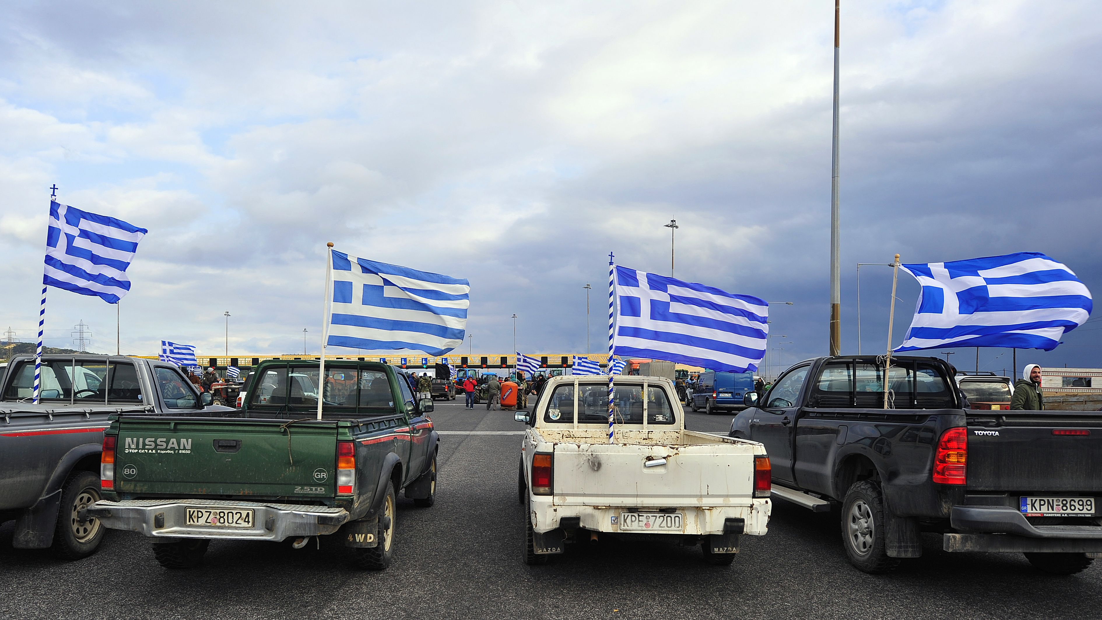 Greek farmers cut off the national road between Athens and Peloponnese at the toll posts near the city of Corinth on Jan. 23, 2016, to protest against the social security reforms planned by the government.