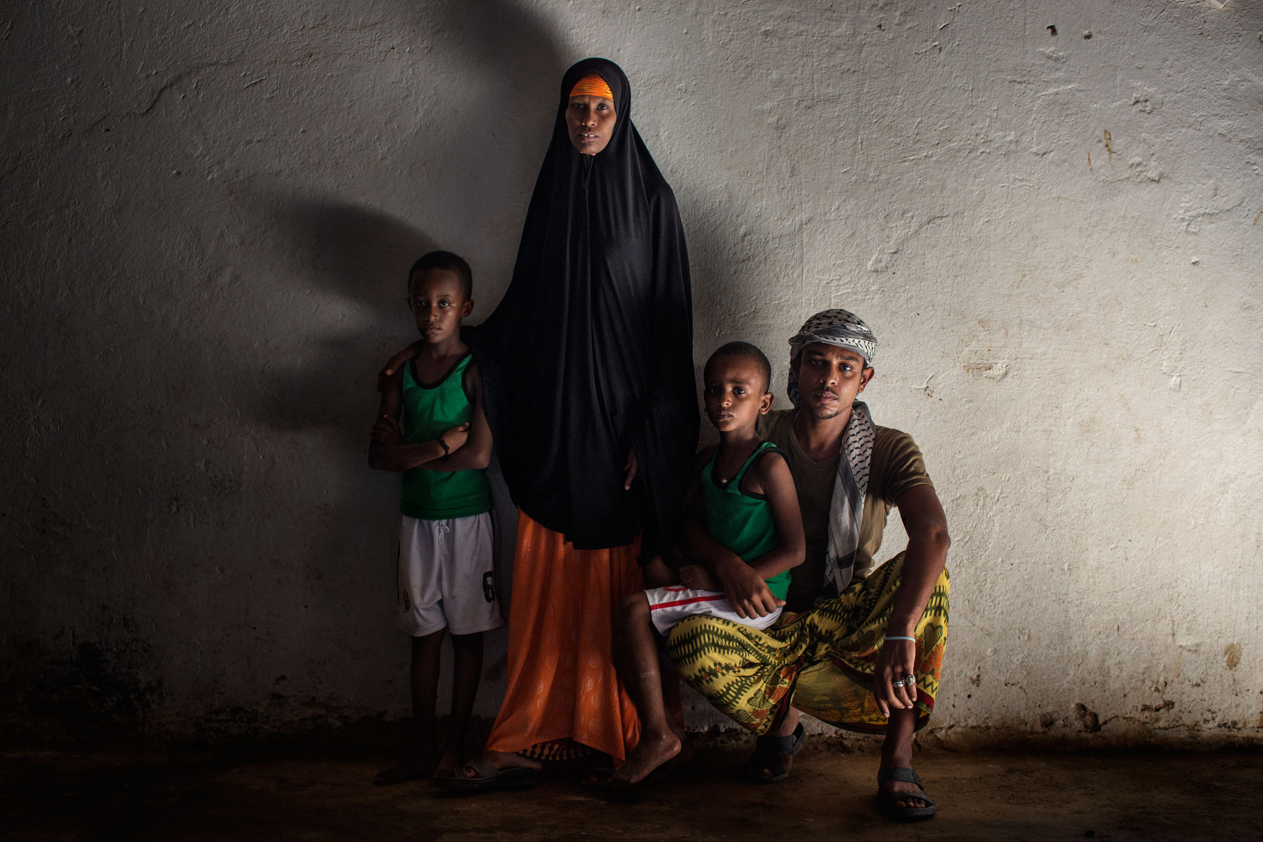 A. Abdalla Ali, a Yemeni refugee from Aden, Yemen, with his wife and their two sons. Abdalla was a house decorator back in his country. He left Yemen with his family when his neighborhood was bombed. Bosaso, Somalia. October 6, 2015.