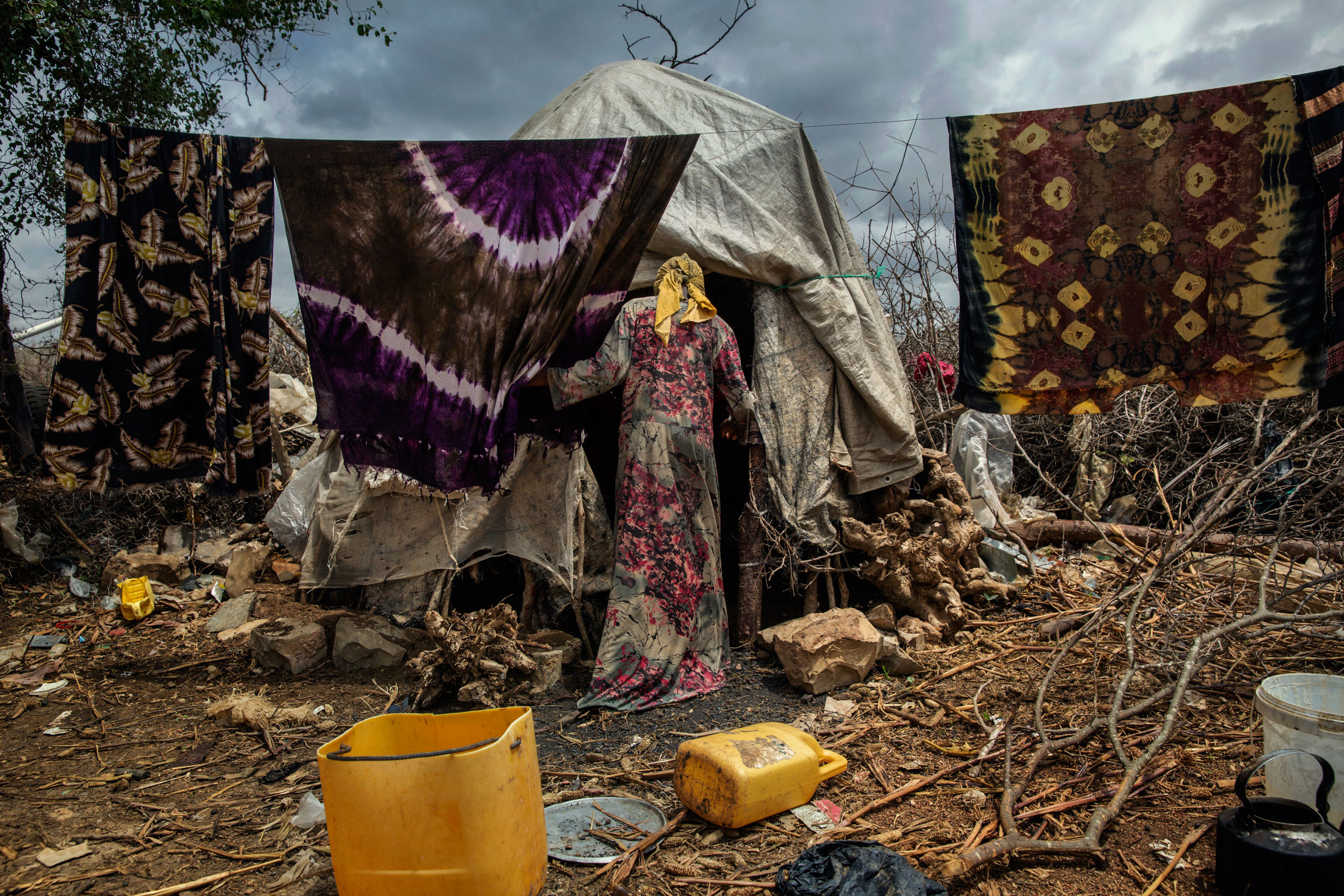 An internally displaced Somali woman walks inside a makeshift camp in Baidoa, in the Bay region, 150 miles from Mogadishu, Somalia. The internally displaced families fled to Baidoa town to escape famine in the surrounding areas. Baidoa, Somalia. October 14, 2015.