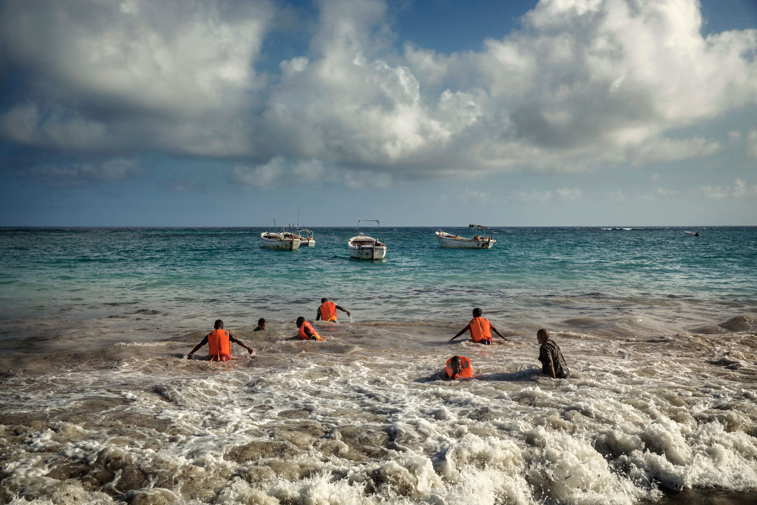 Young men learn how to swim in the seacoast Abdiaziz District in the southeastern Banaadir region of Somalia, as part of a program by the Fishing Training Center, founded by Unicef and N.R.C. and run by local organizations. Mogadishu, Somalia. October 12, 2015.