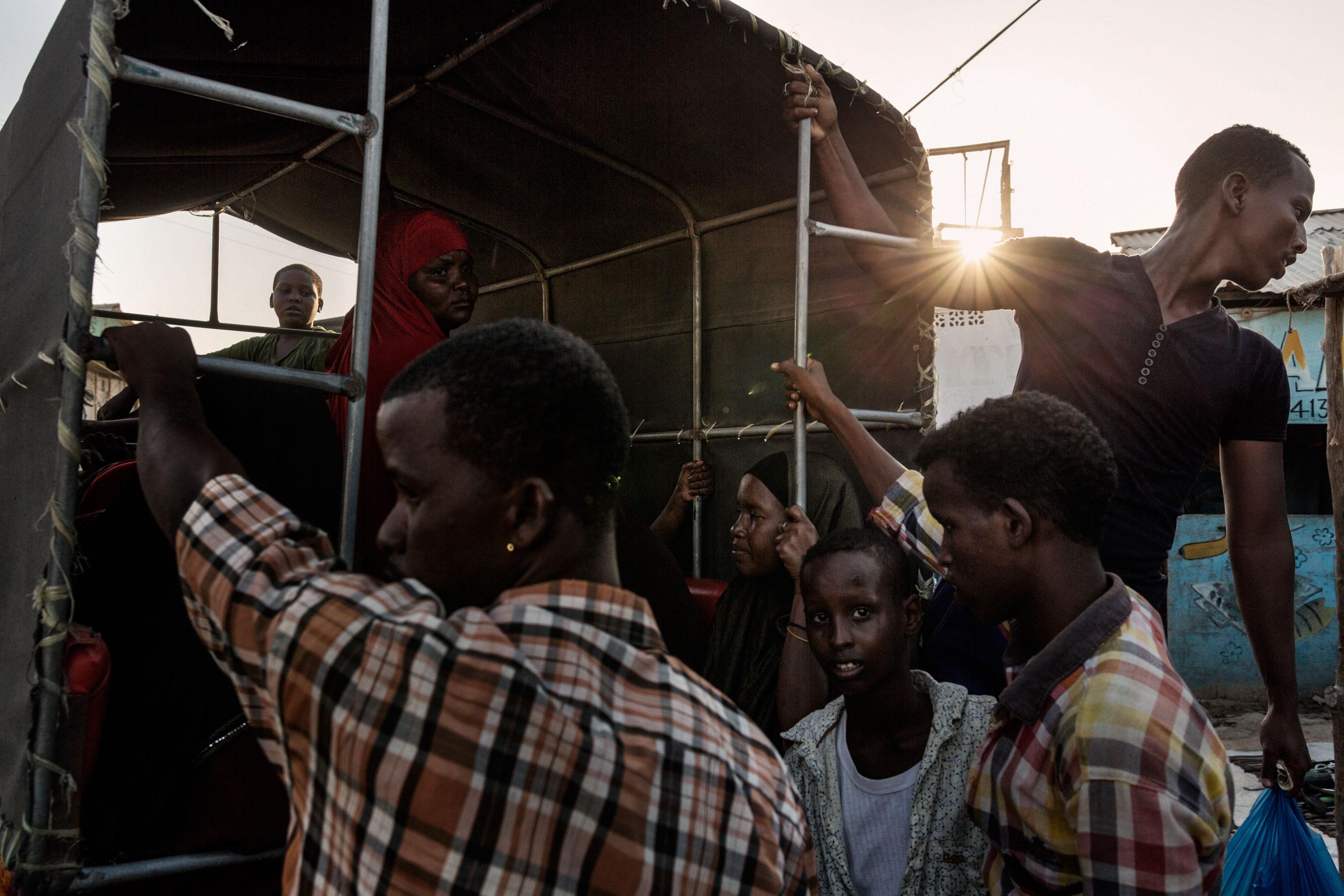Locals commute daily using rickshaws, a common mean of transportation among Somalis. Bosaso, Somalia. October 5, 2015