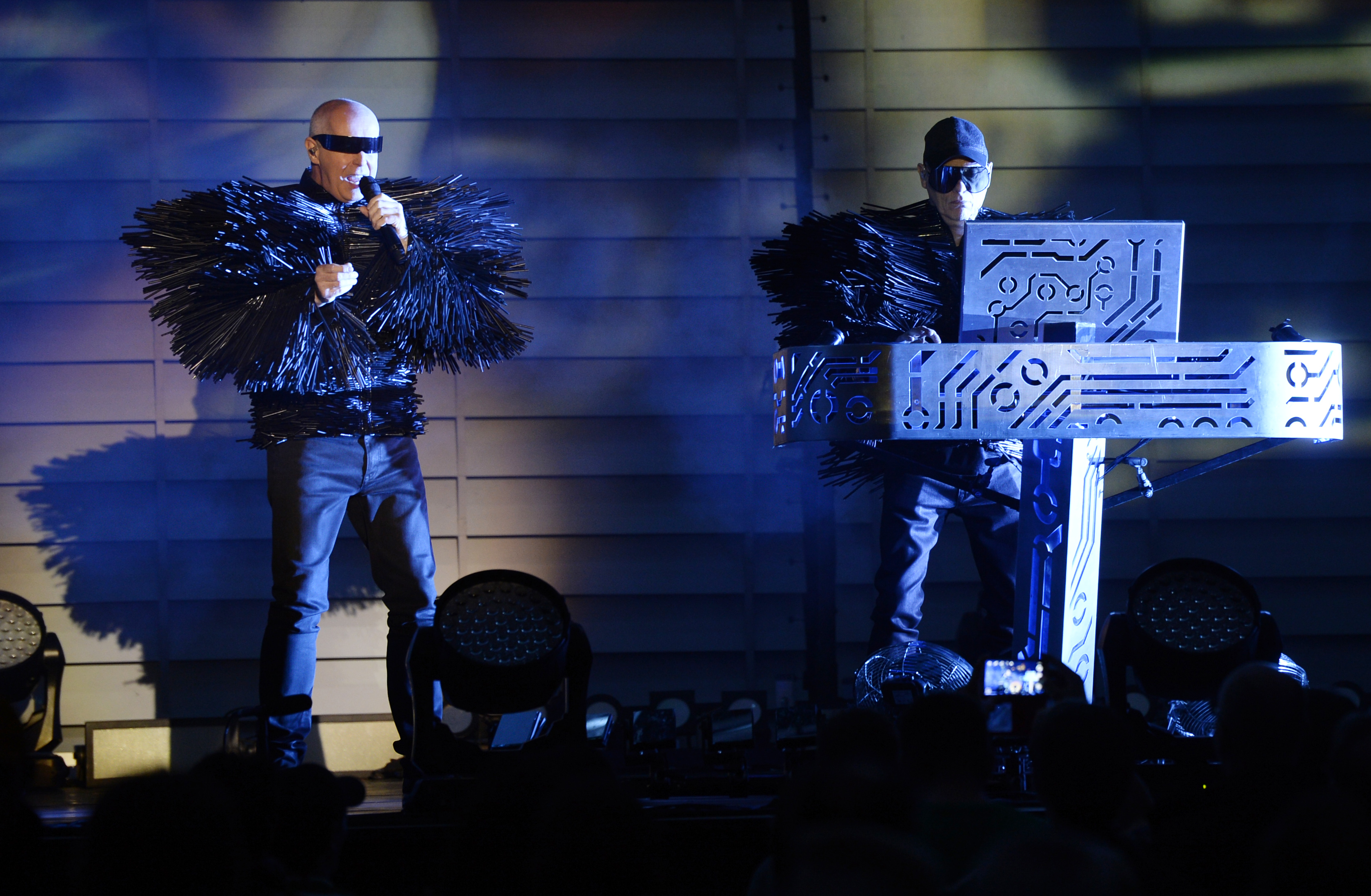 British singer Neil Tennant and keyboard player Christopher Lowe of electronic pop duo Pet Shop Boys perform during their concert  at the Live at Sunset festival, in Zurich, Switzerland, July 14 2014.