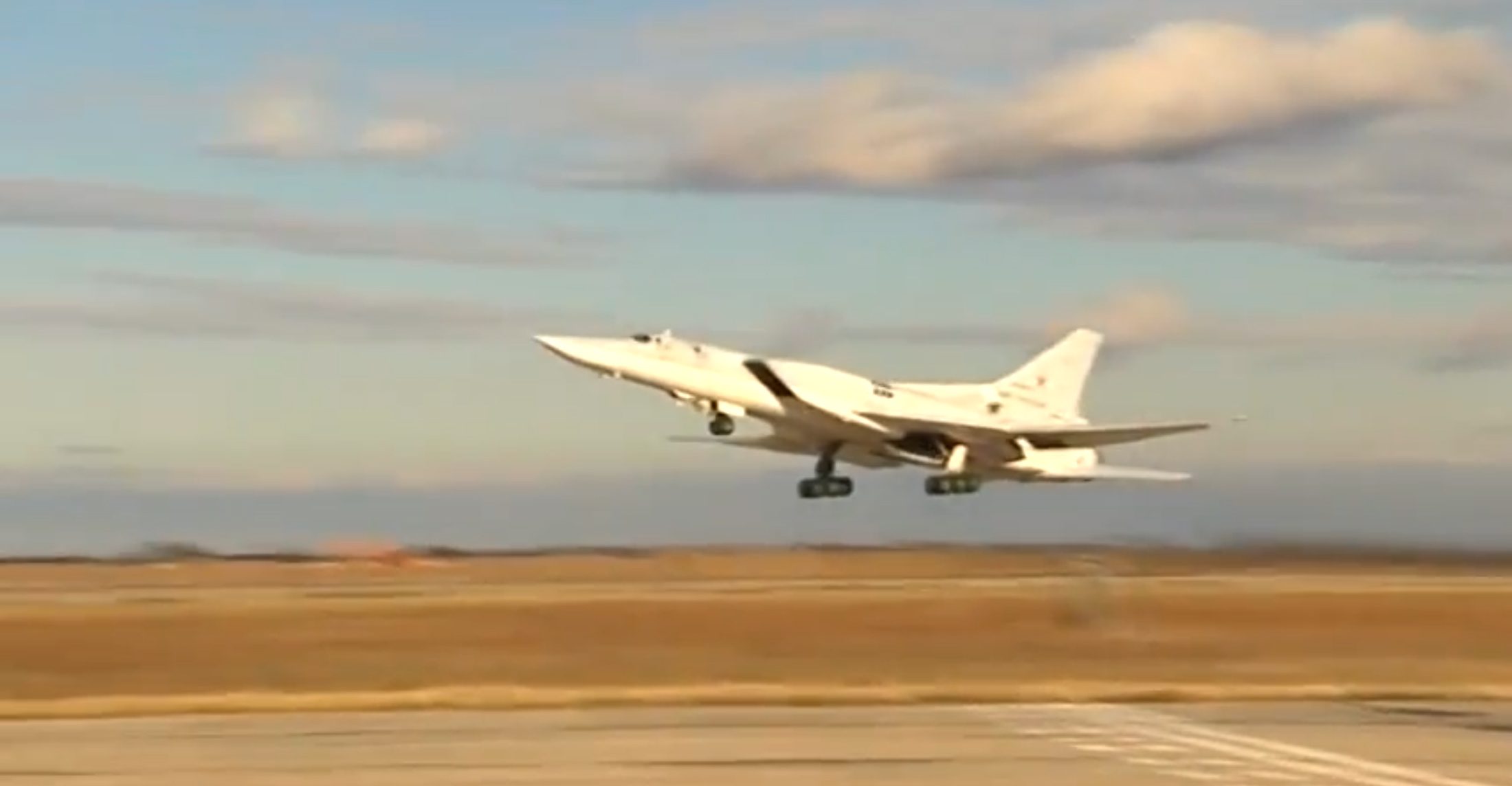 A handout frame grab from video footage published on the official website of the Russian Defense Ministry on Nov. 18, 2015, shows Russian TU-22M3 long-range strategic bomber based in Russia taking off for mission in Syria