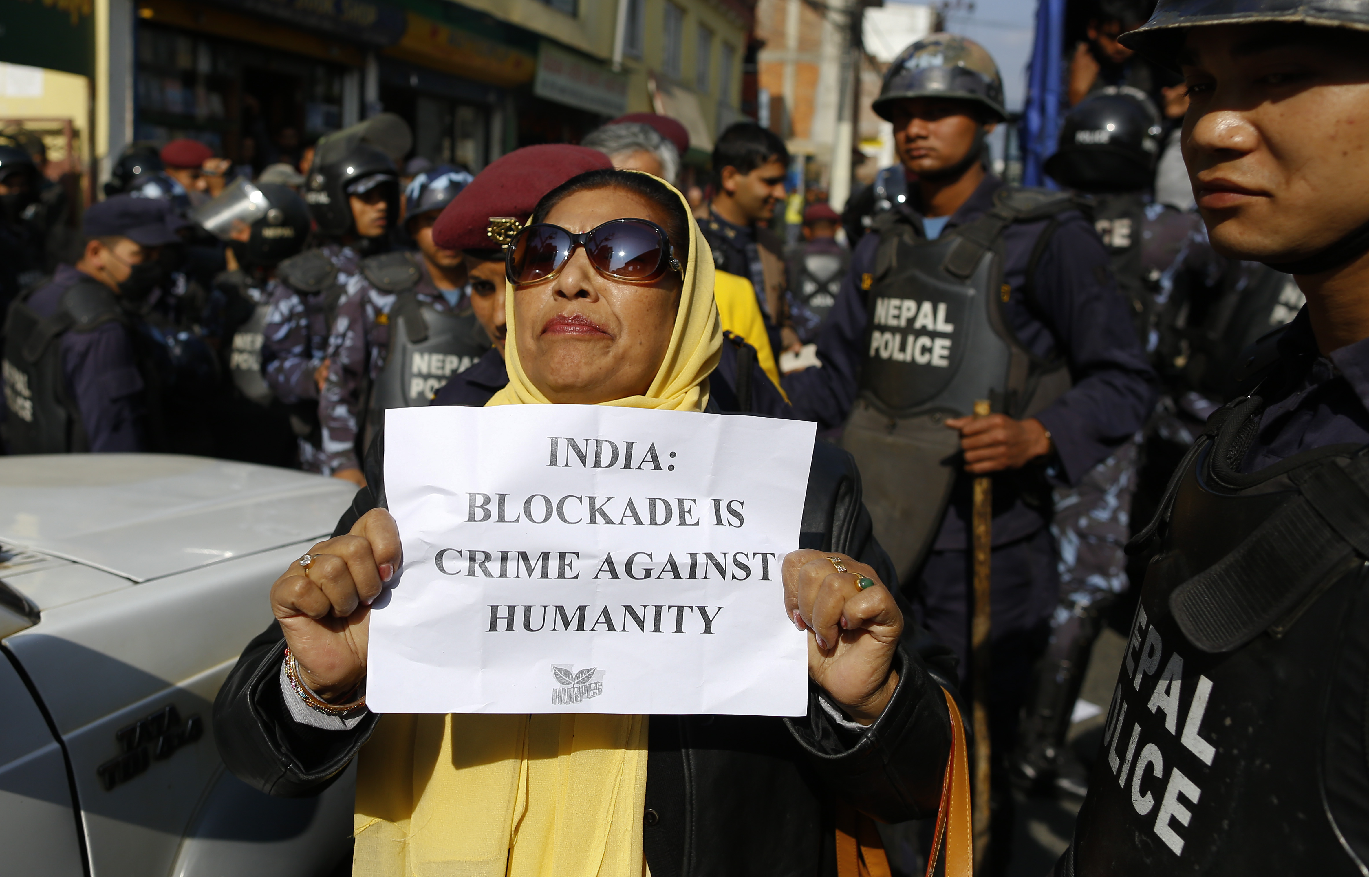 A group of Nepalese human-rights activists shout slogans against the border blockade by India during a protest rally in front of the Indian embassy in Kathmandu on Dec. 10, 2015